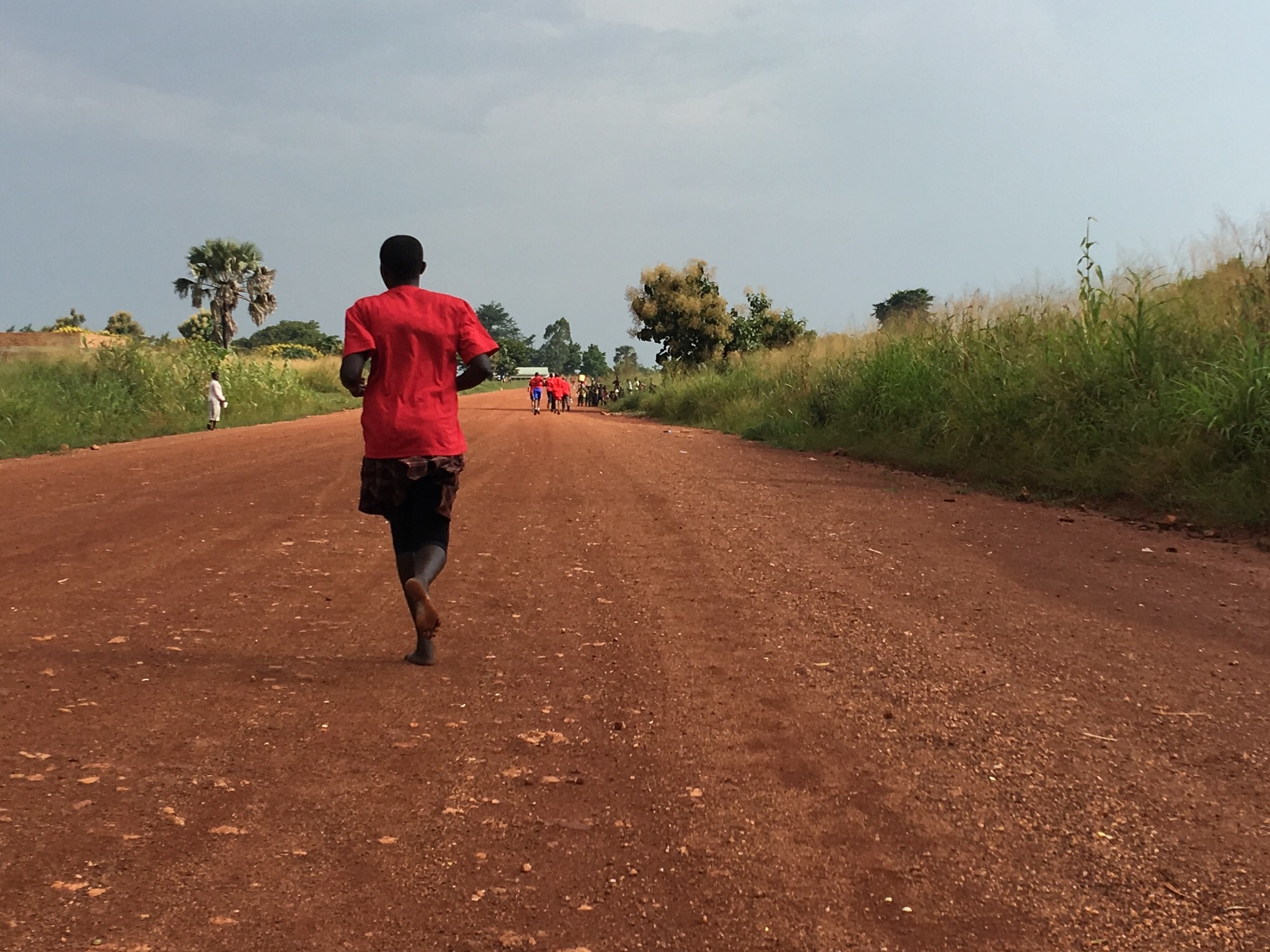 Martha runs barefoot during Run 4 Their Lives Uganda.