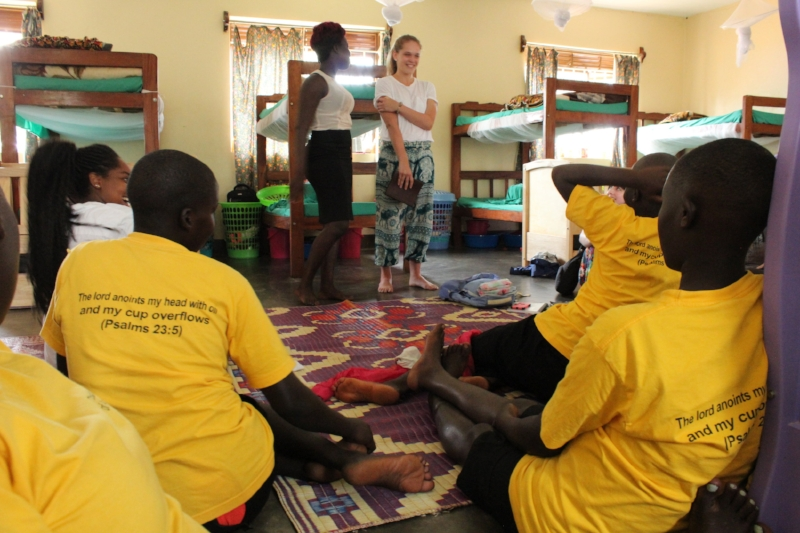 The team sharing testimonies on their first day in Gulu.