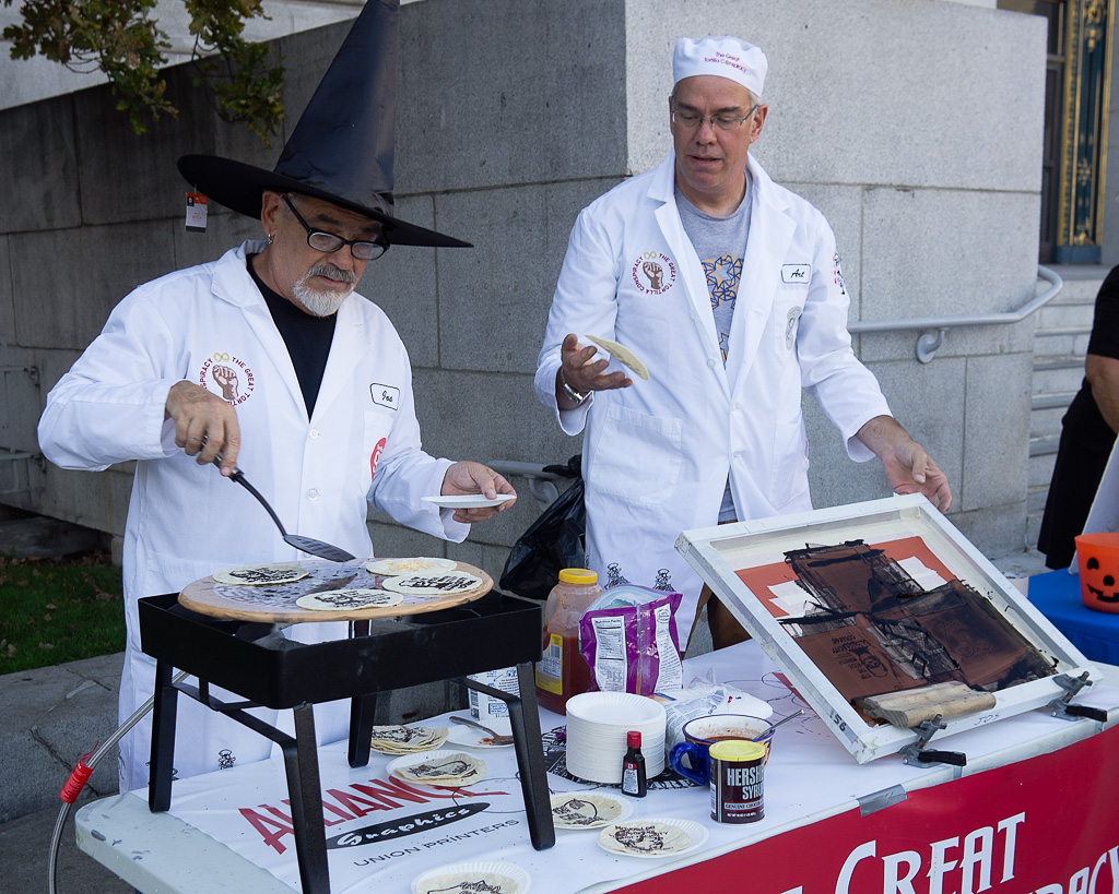 Artists Jos Sances and Art Hazelwood at the Halloween Rally to Protect City College at Civic Center in San Francisco.
