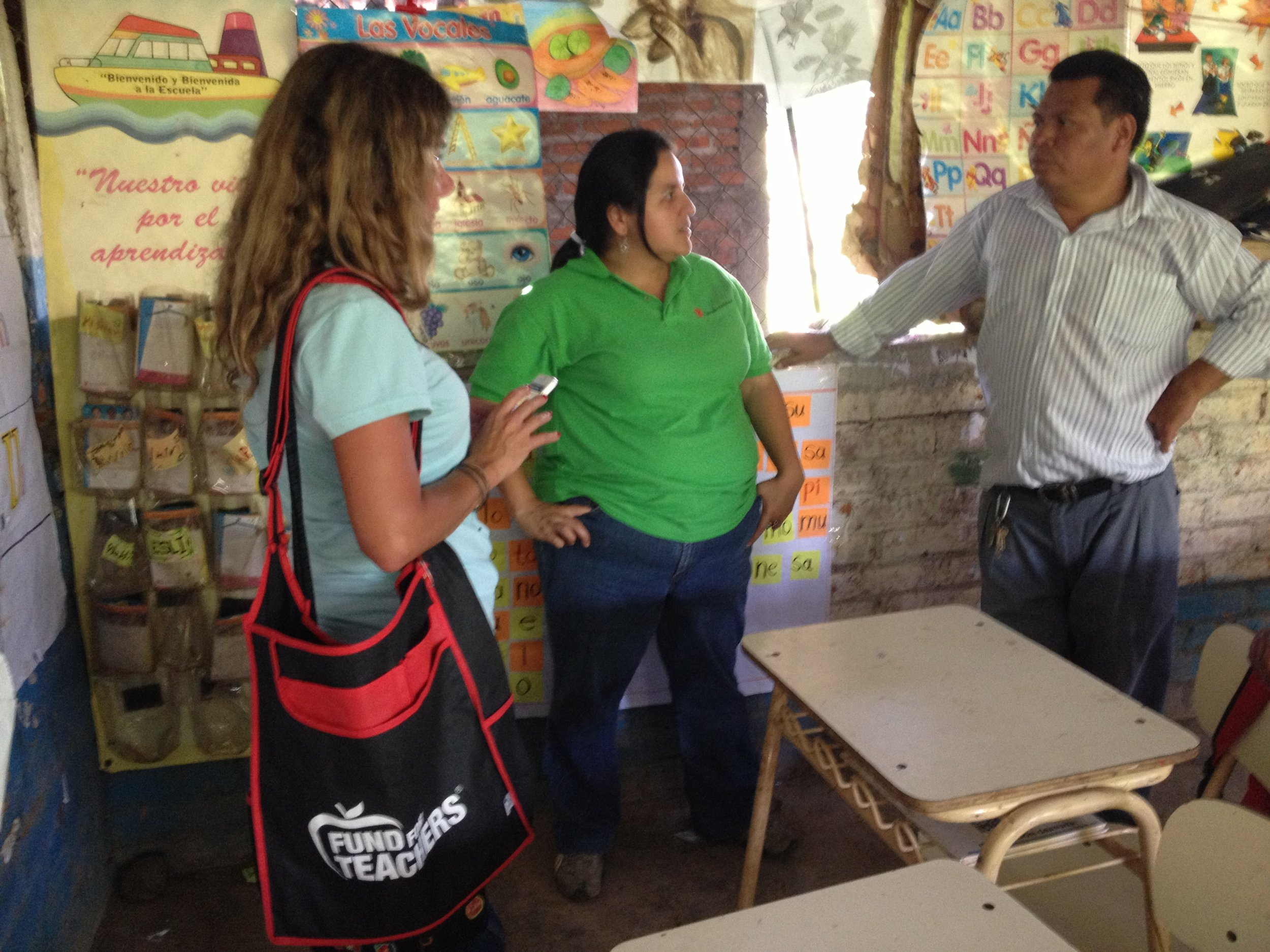 Talking to a teacher with a Save the Children worker in the country near the Honduran border in El Salvador.