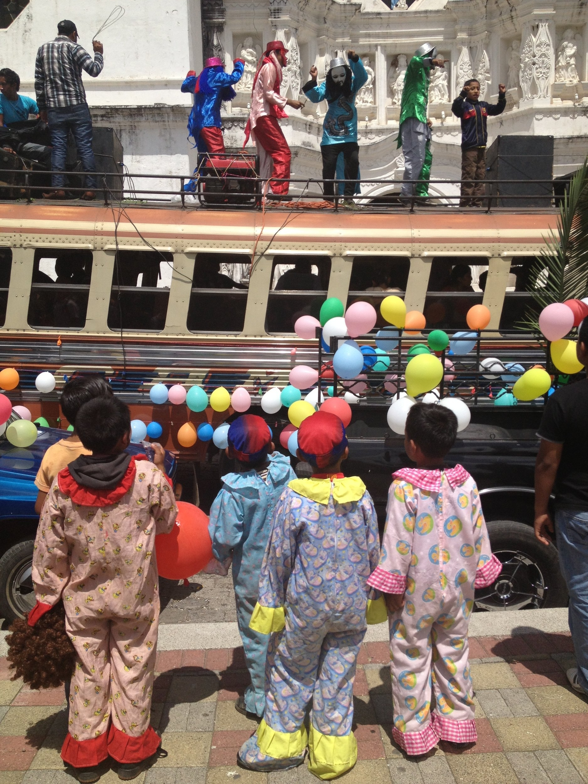 Little clowns watching a St Christopher day parade. One of the dozens of parades we enjoyed in Central America.