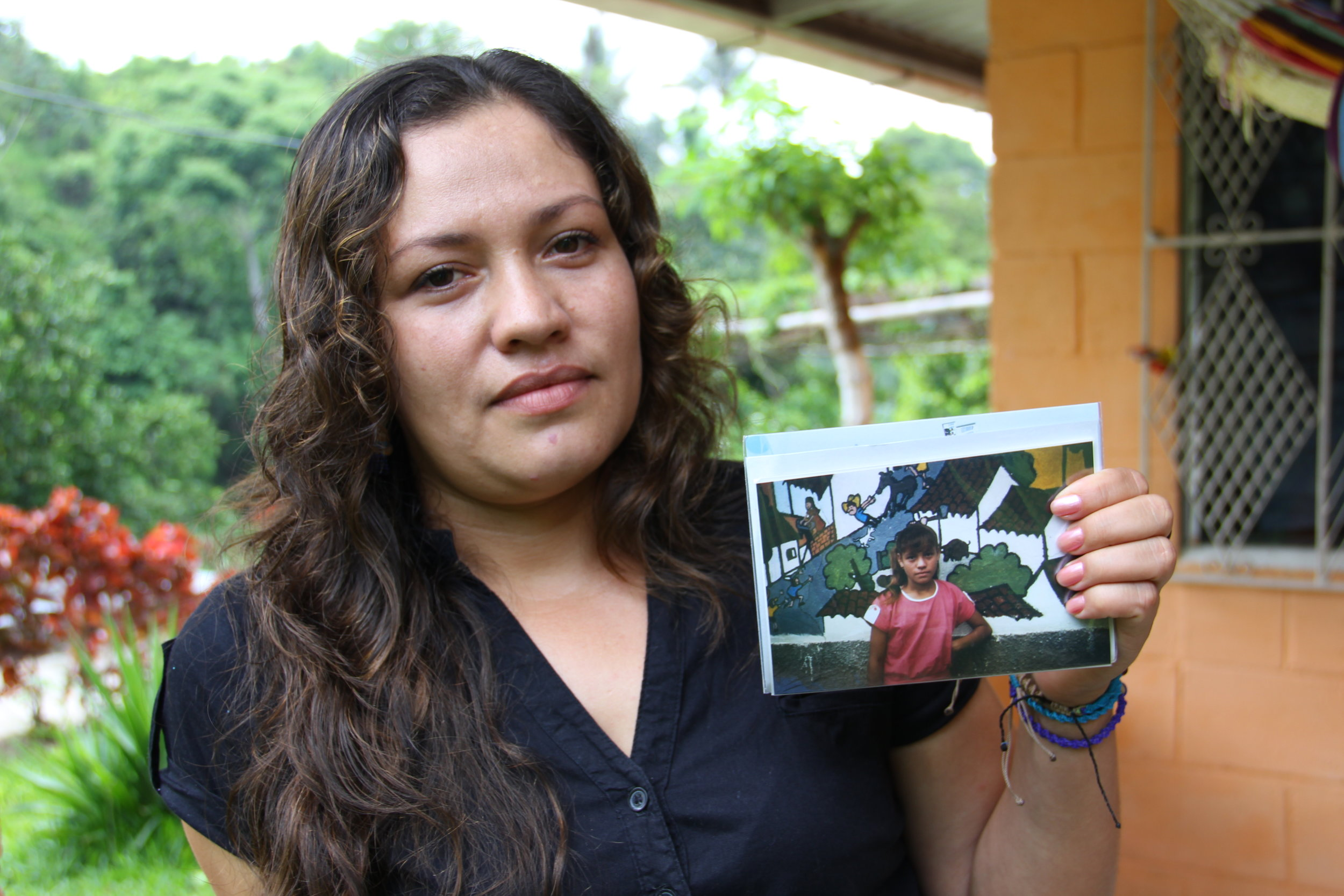 Yesenia remembers hiding from soldiers during the war. Now she is raising her son in El Salvador on her own while her husband works in the U.S. Photo by Pat Goudvis.
