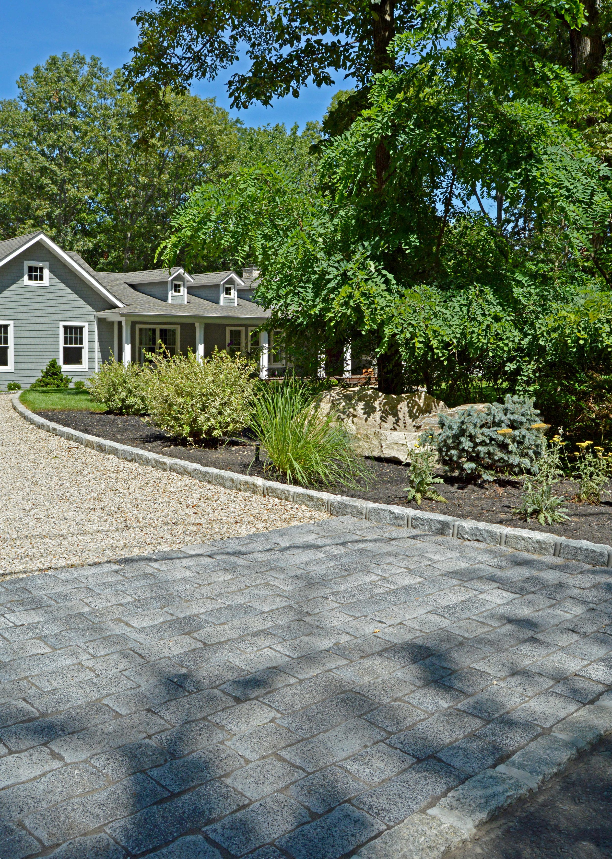 driveway skirt with pavers and pea gravel in Port Jefferson, NY