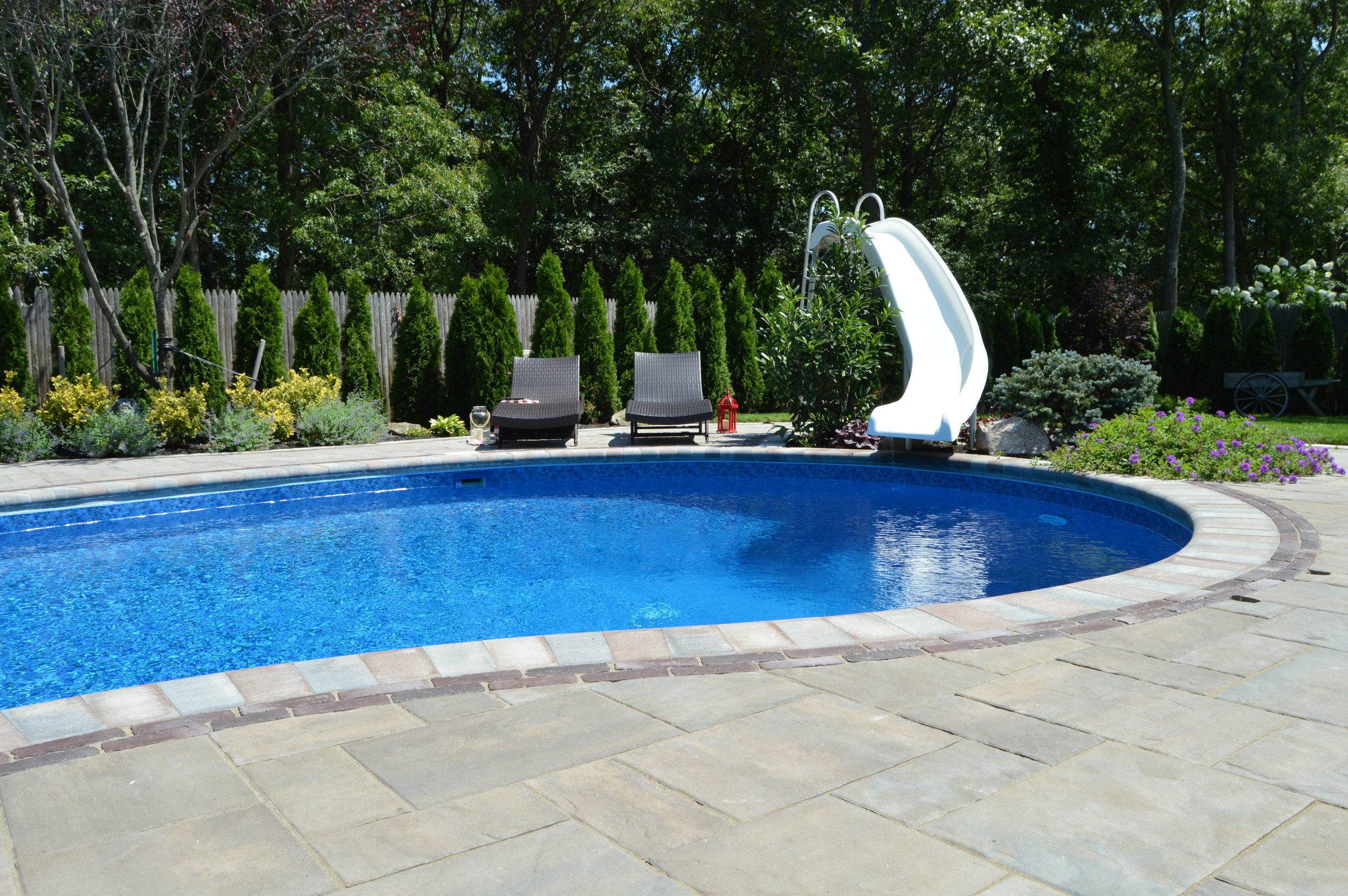 swimming pool with slide in Smithtown, NY