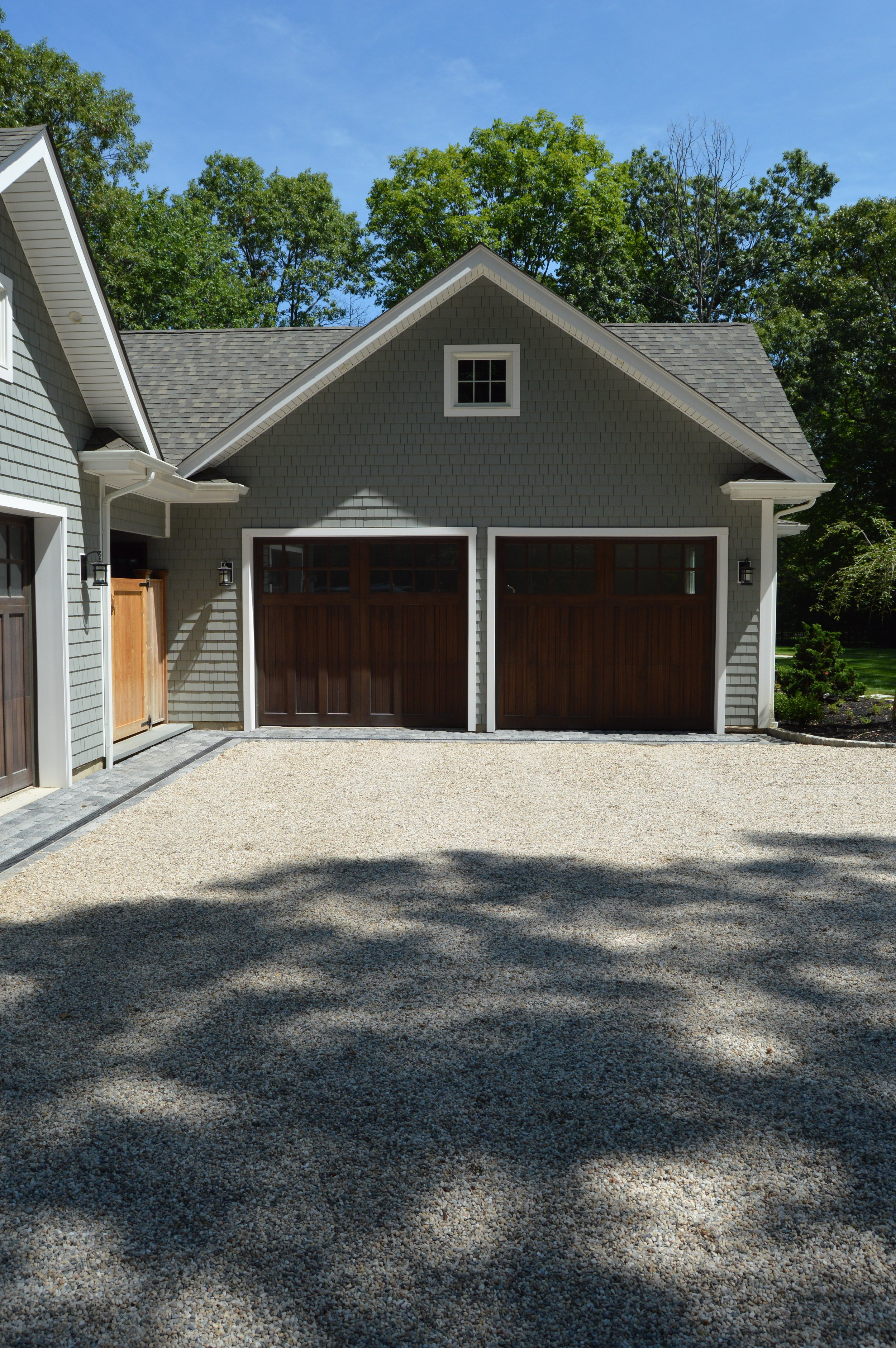 concrete pavers for driveway skirt and pea gravel driveway in Long Island, NY