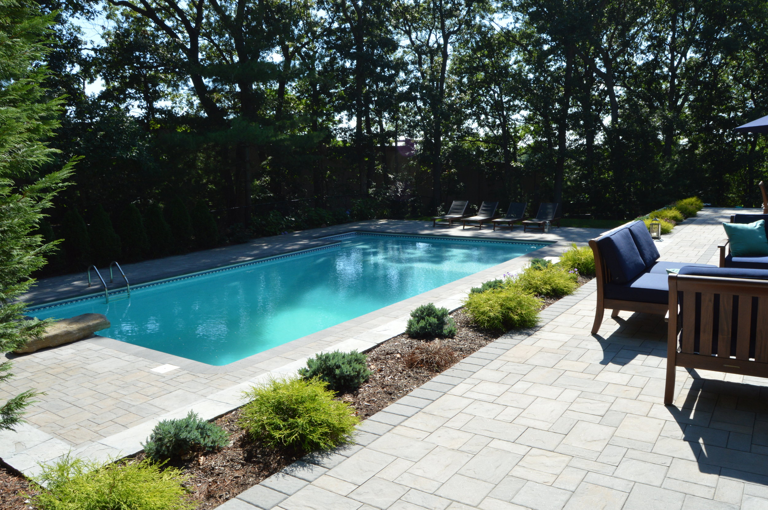 Backyard designs with pools in Huntington, NY