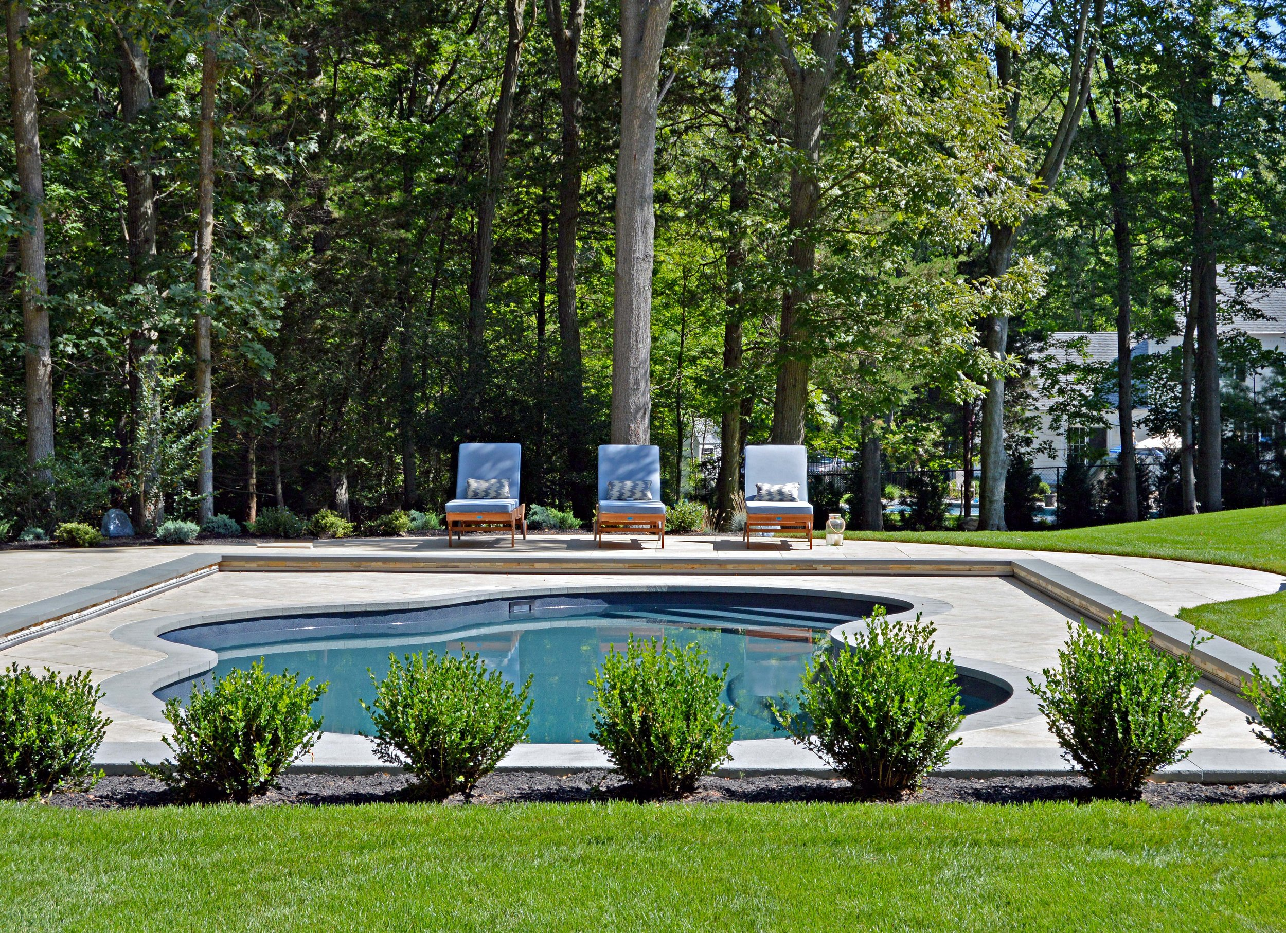 Backyard designs with swimming pools in Huntington NY