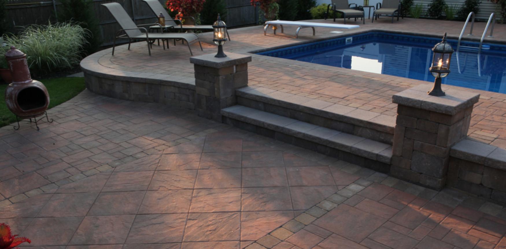 swimming pool patio with Cambridge paving stones in Nesconset, NY