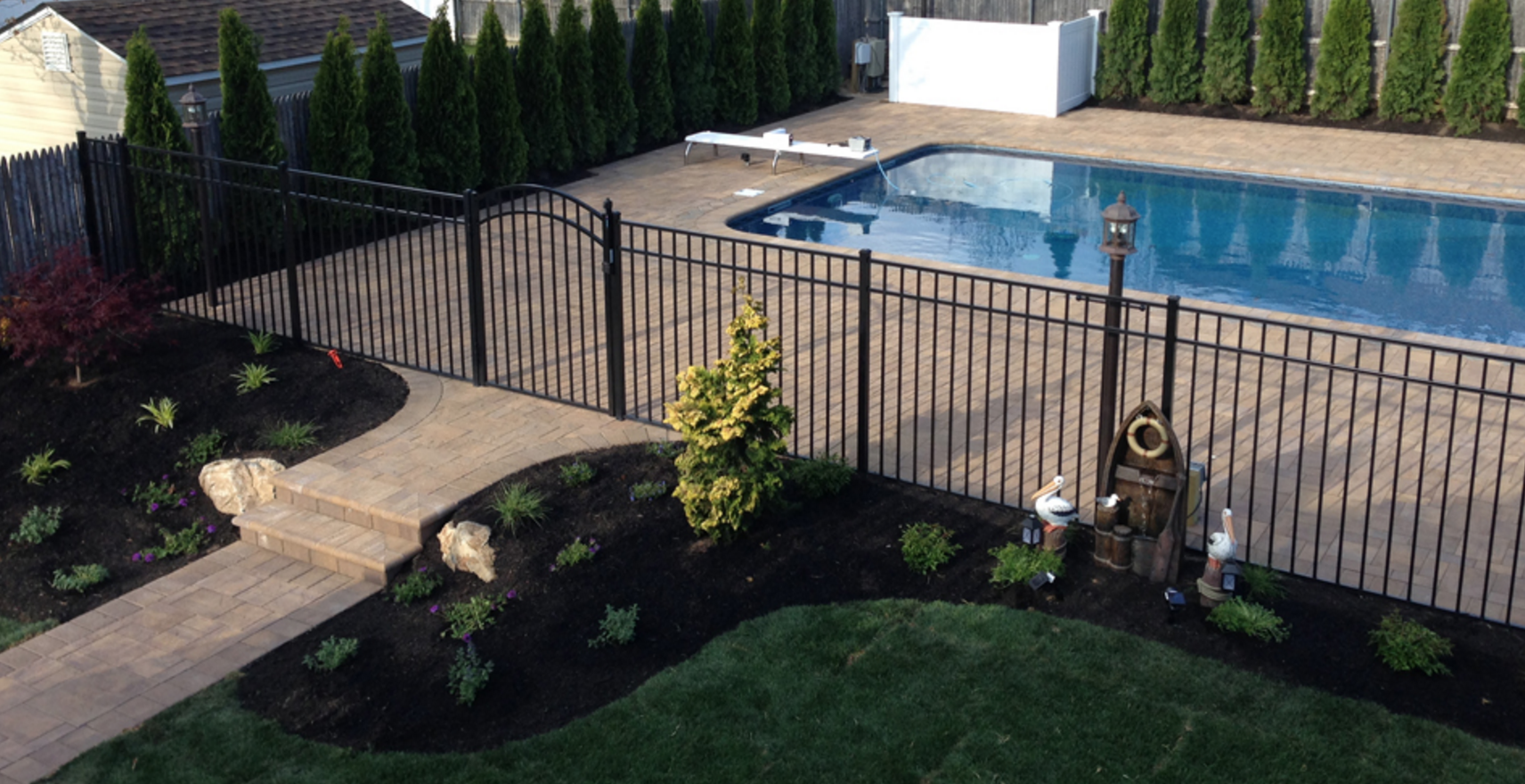 Centereach, NY fenced in swimming pool patio