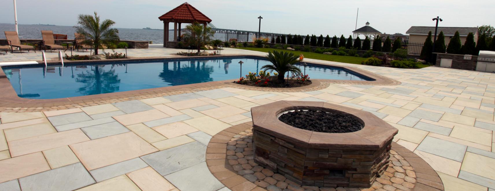 West Islip, NY swimming pool patio and fire pit