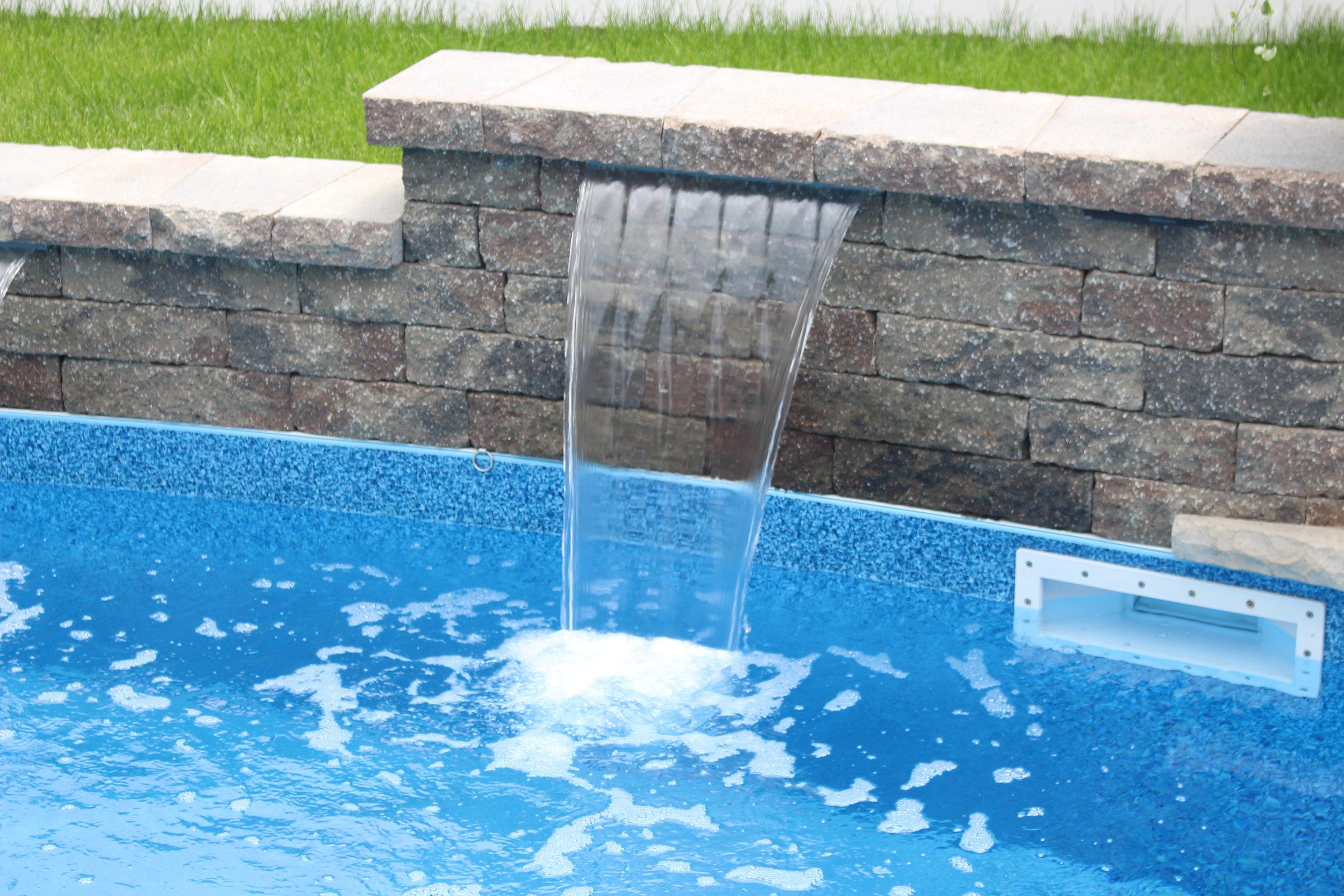 Massapequa, NY Unilock waterfall and swimming pool