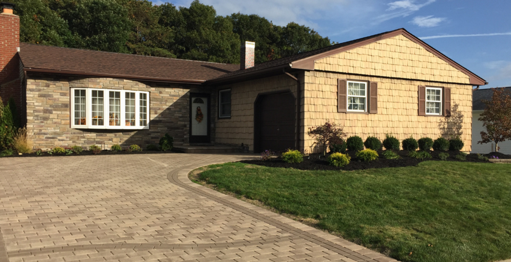 stone siding and paver driveway in a house in Holbrook, NY
