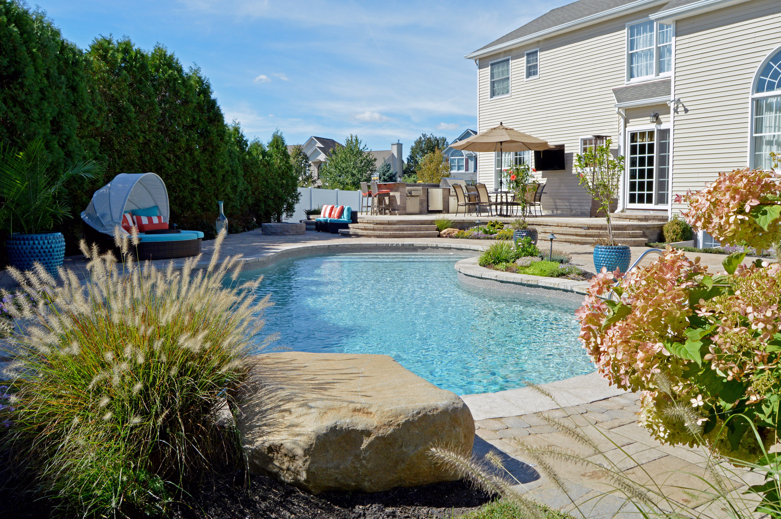 Smithtown, NY swimming pool, custom outdoor kitchen and bar and grill