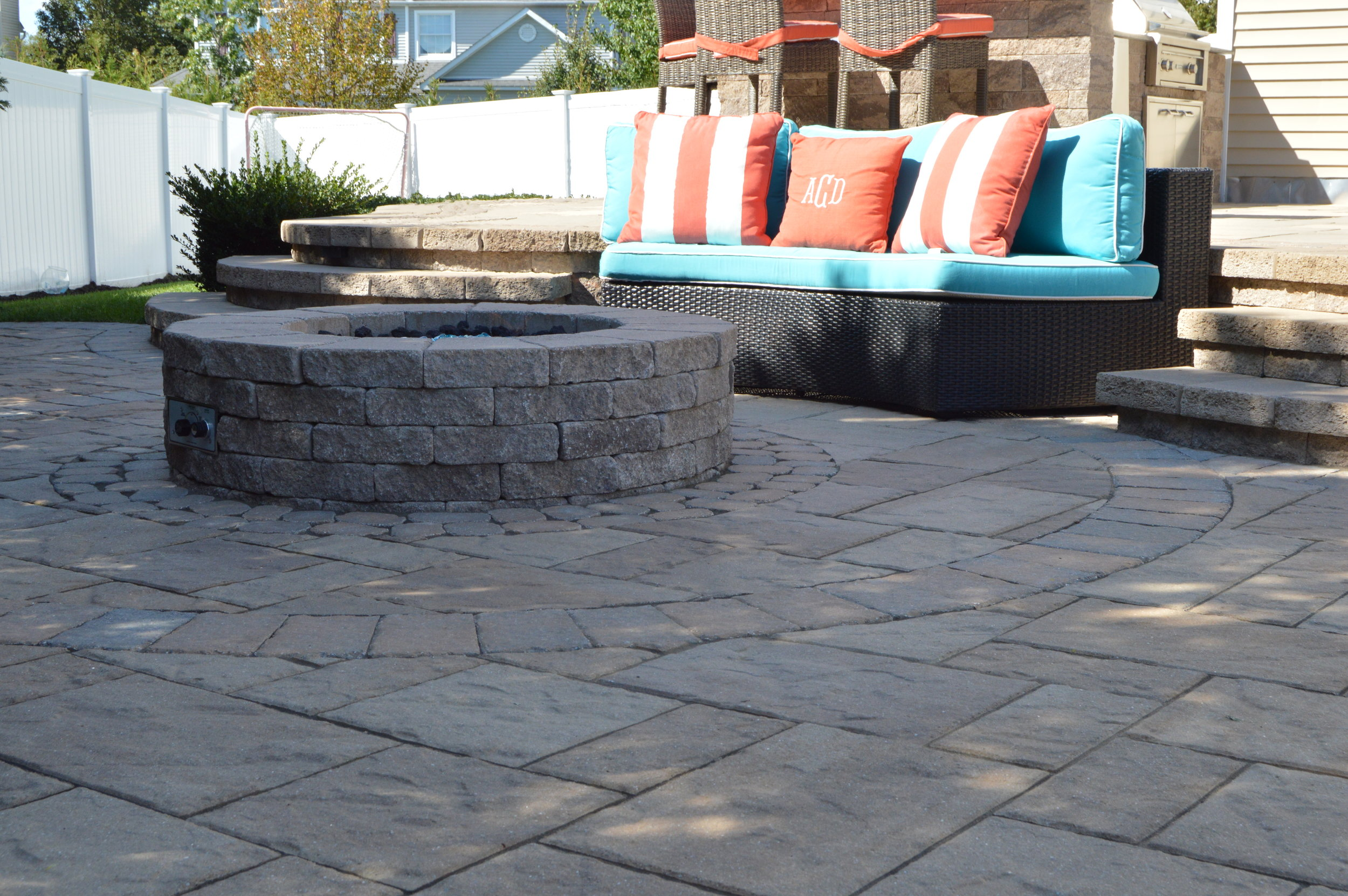 Smithtown, NY swimming pool and paver fire pit