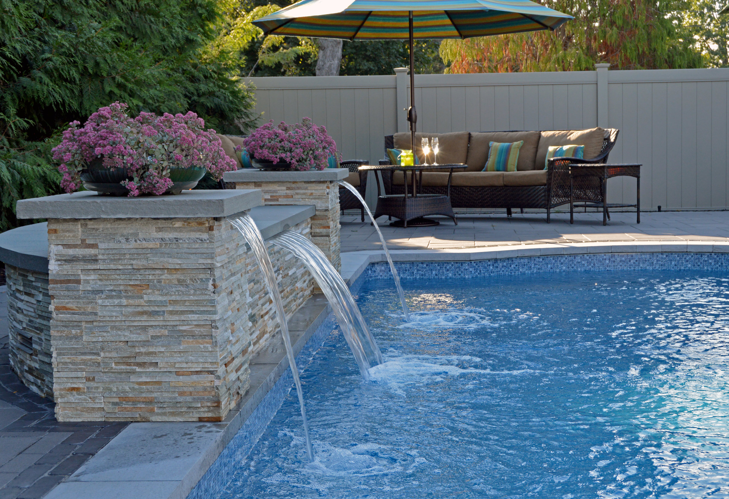 Hicksville, NY fire feature in swimming pool and paver patio