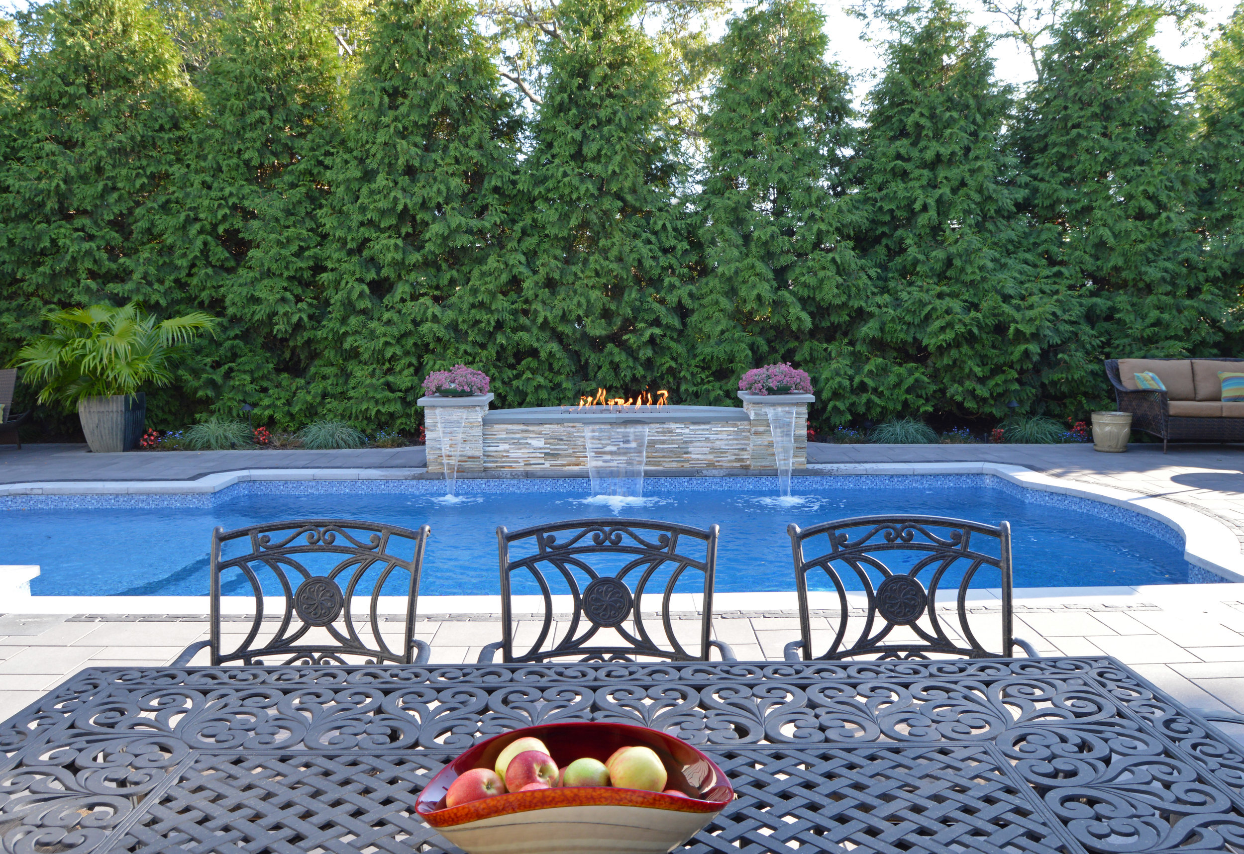 Custom outdoor fireplace and fire pit in Syosset, NY