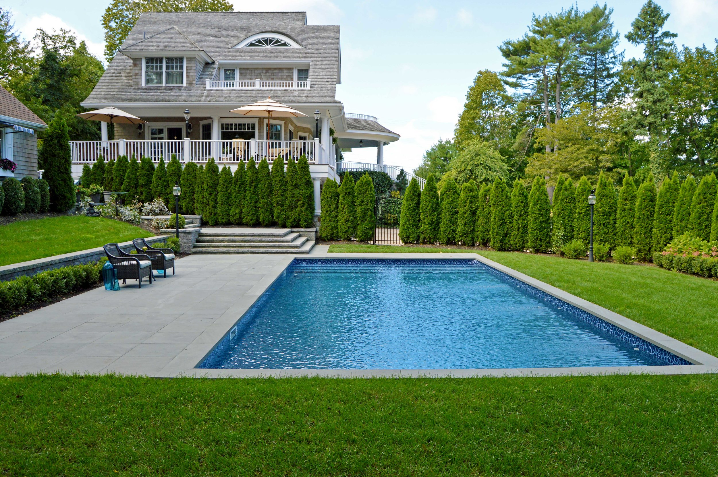 Northport, NY modern patio and swimming pool hamptons style