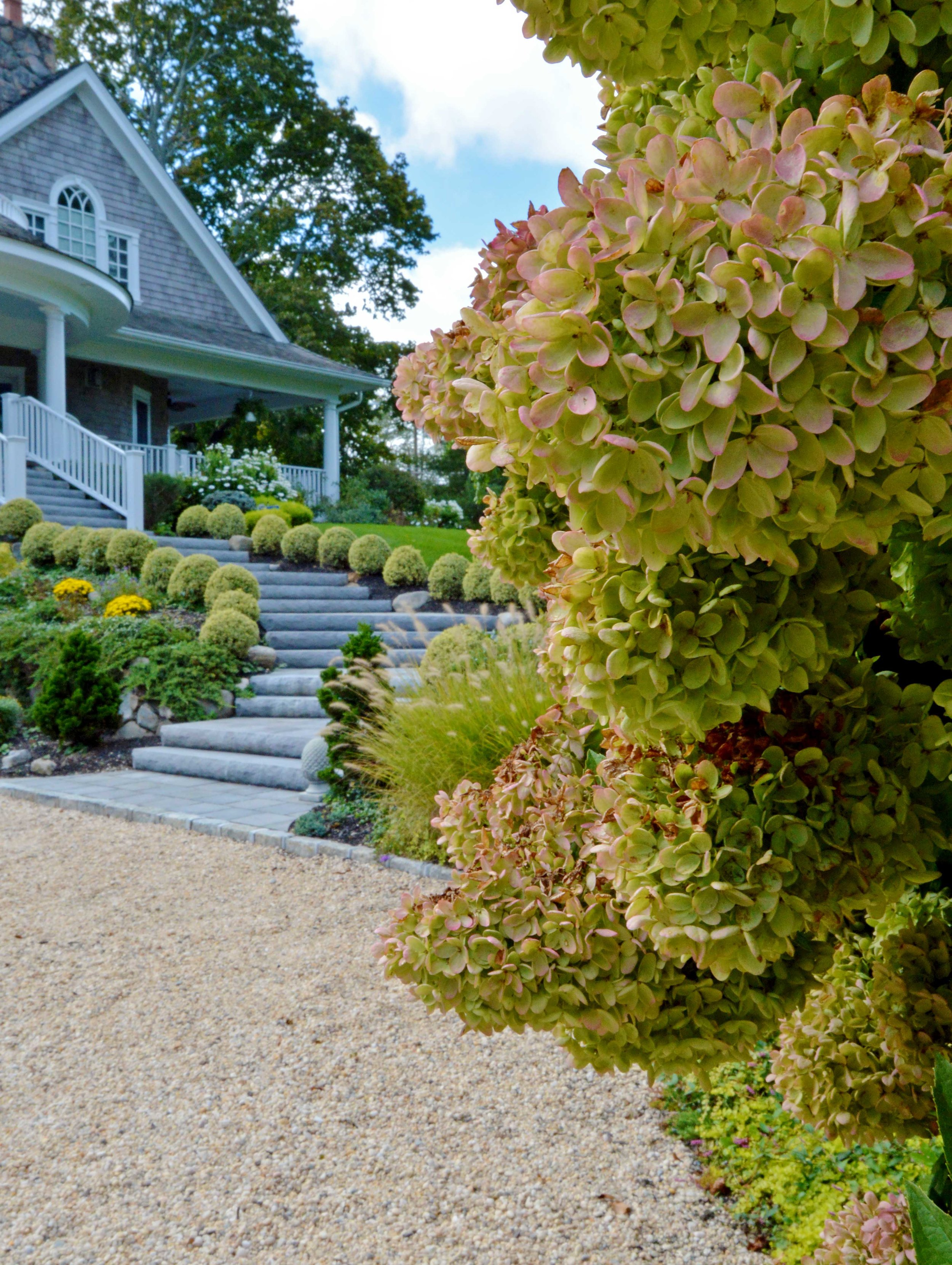 natural steps and gravel driveway in Hamptons style for a Northport, NY home