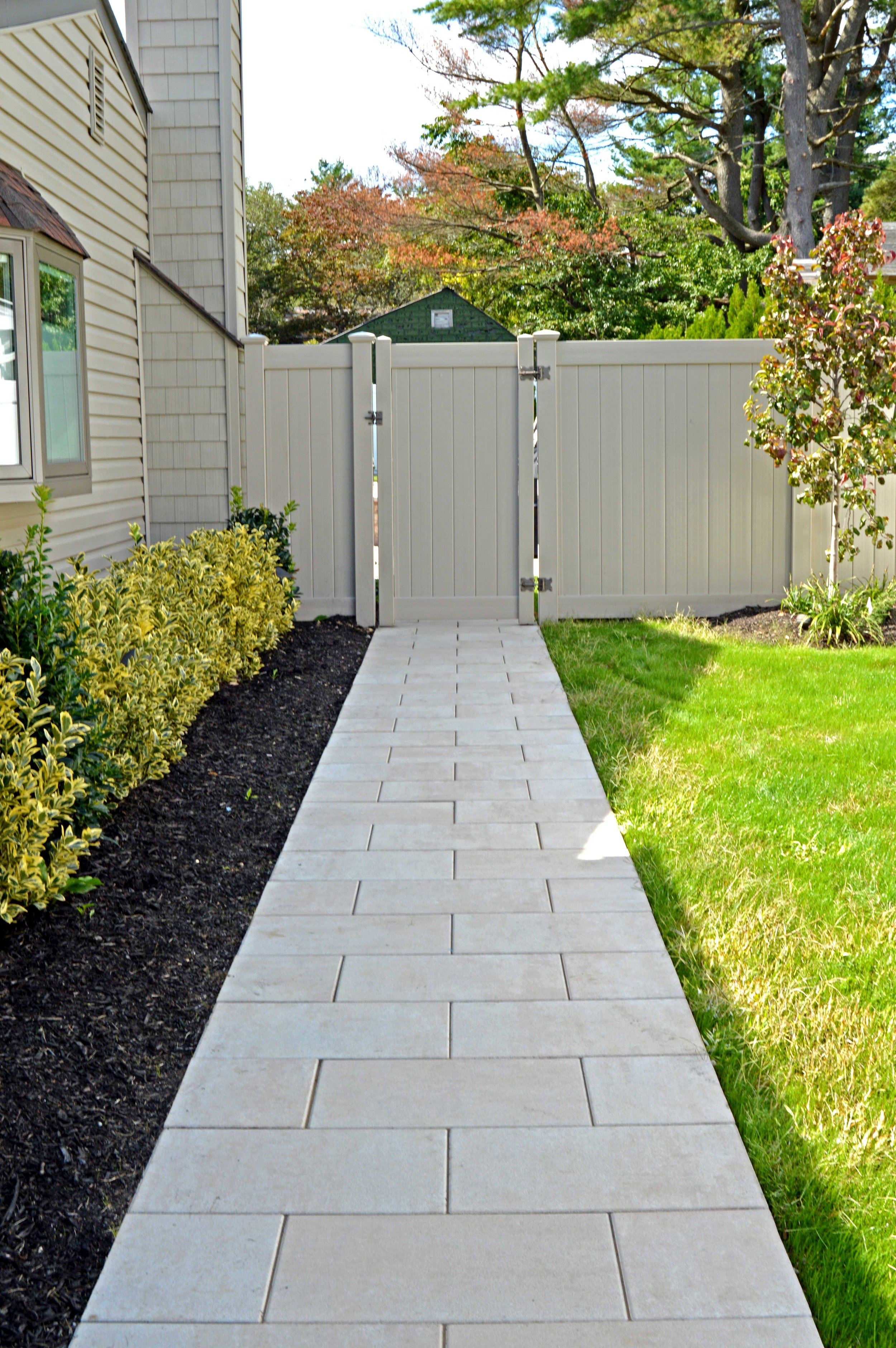 Landscape design with walkway in Hauppauge, NY