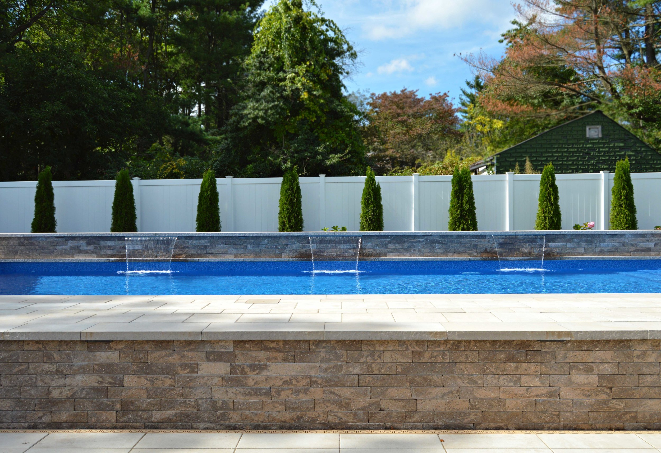 Landscape design with poolside in Hauppauge, NY