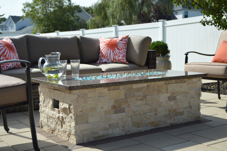 Patio design with a fire pit in Syosset, NY