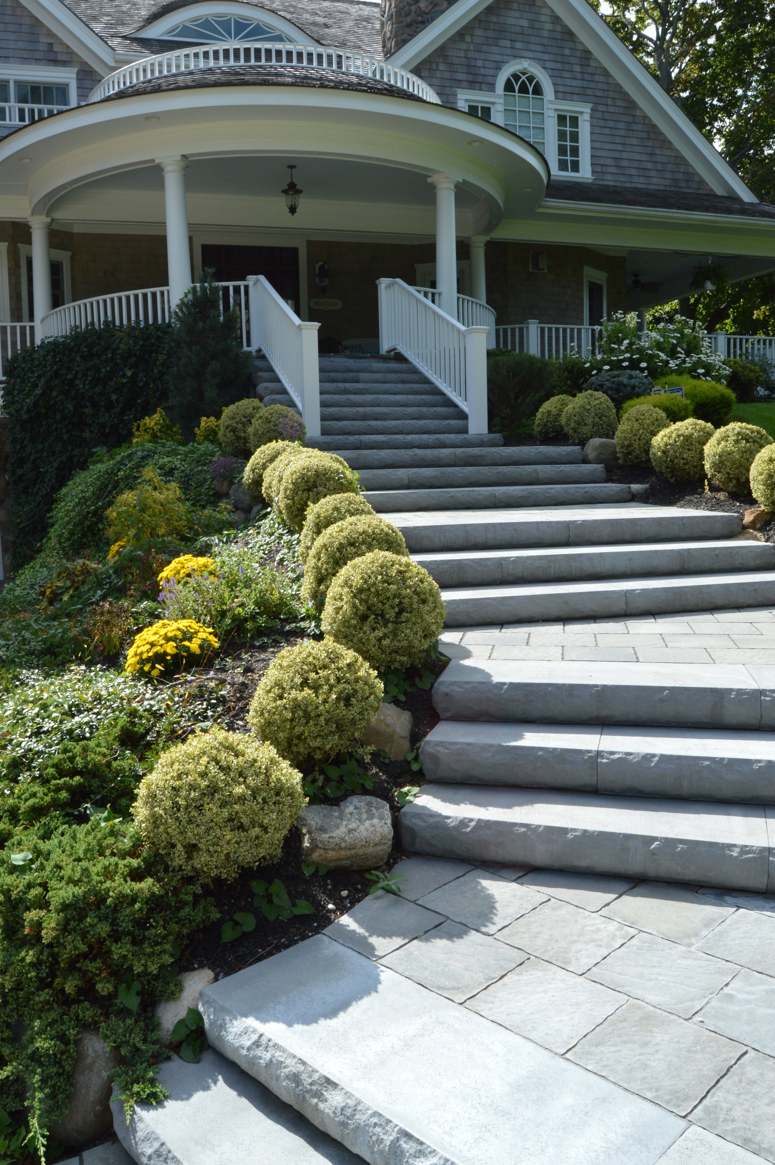 Transform Your Hicksville, NY Front Yard Landscape Design with an Elevated Porch