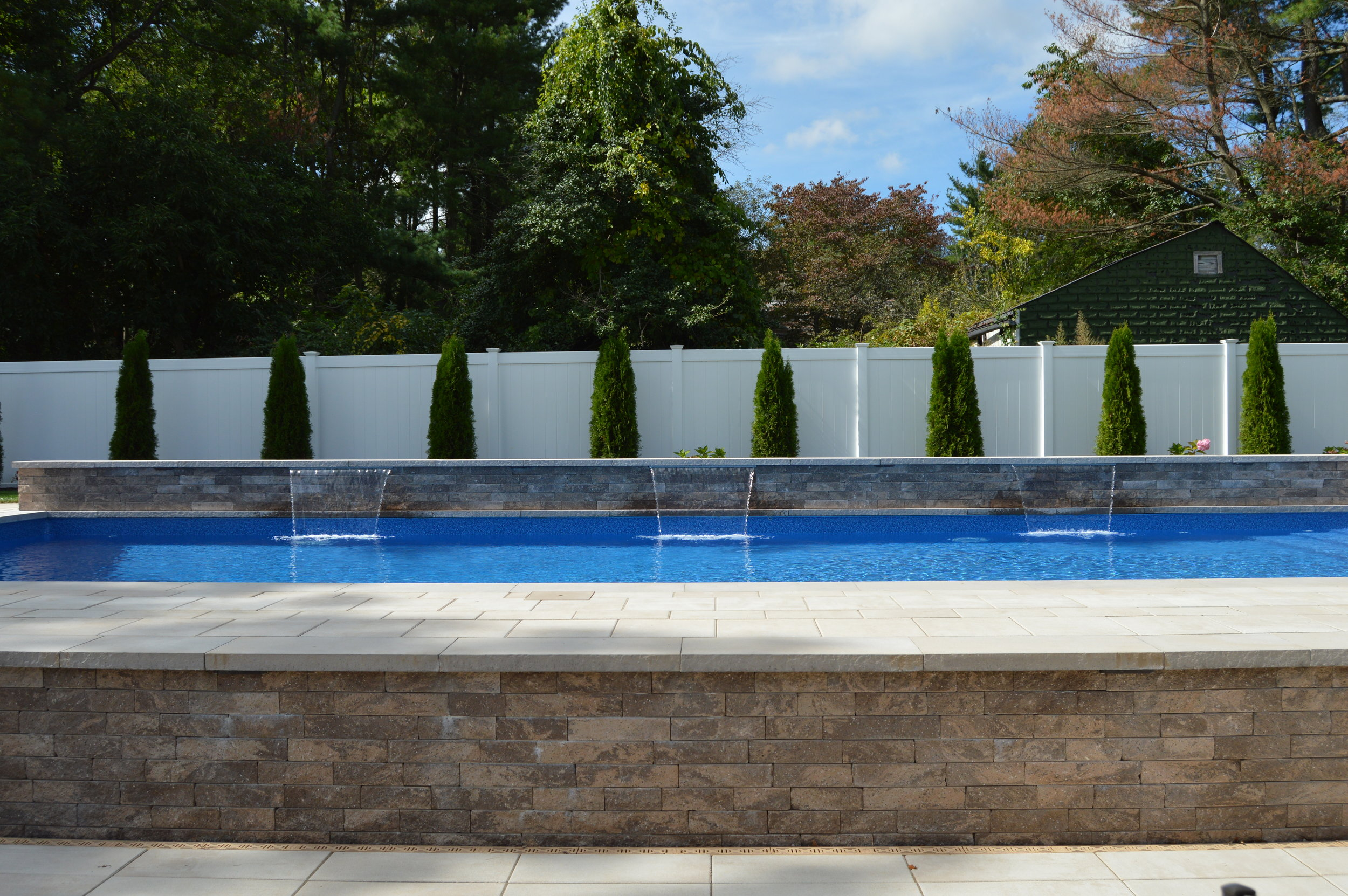 Add Charm to Your Oyster Bay, NY, Swimming Pool with Waterfalls