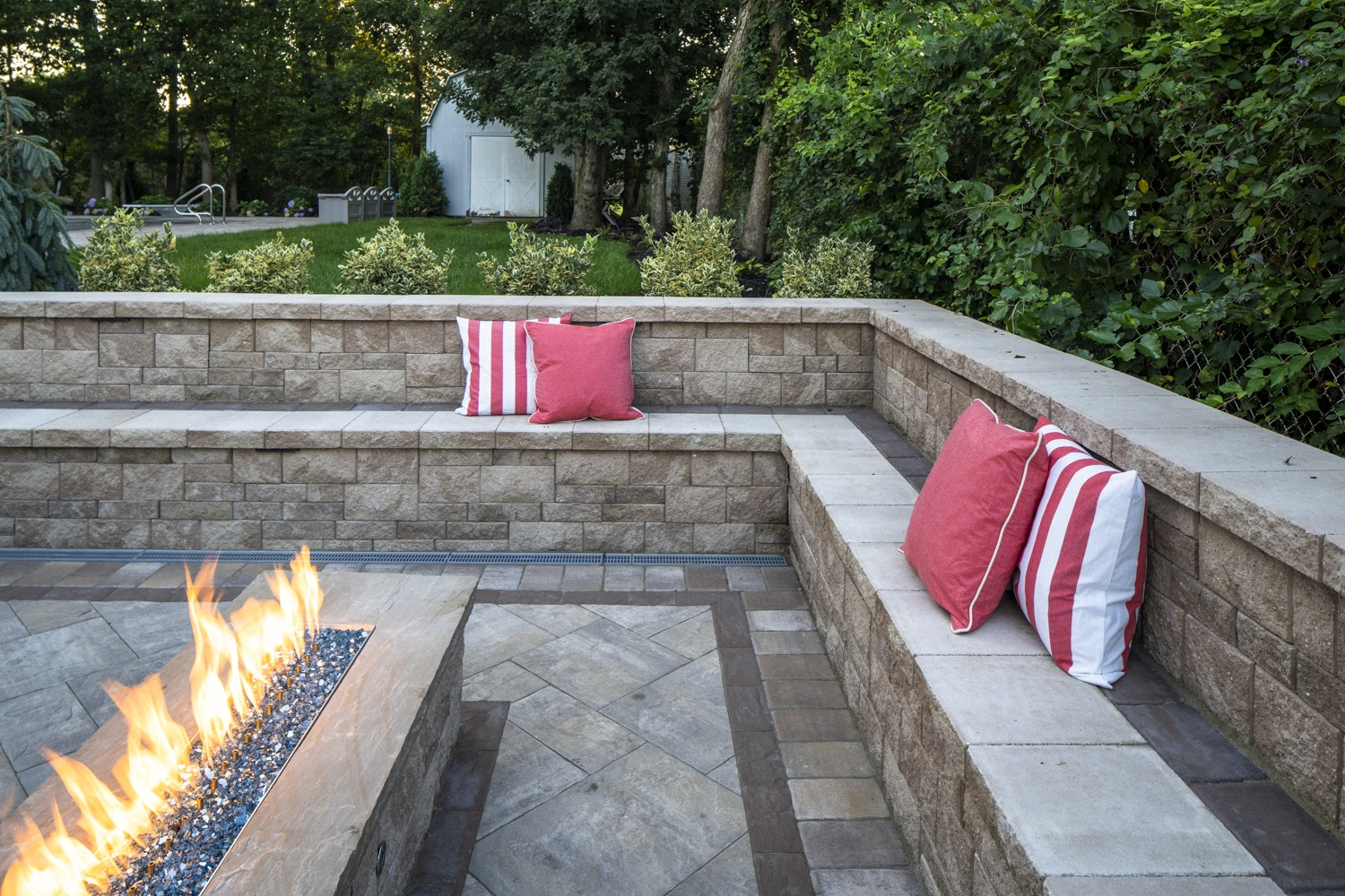 Landscape design with an outdoor fireplace in Plainview NY