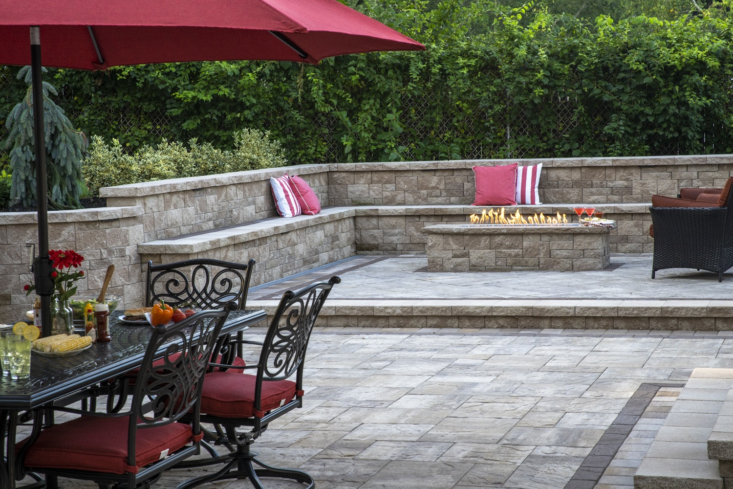 Landscape design with outdoor fireplace in Bethpage NY