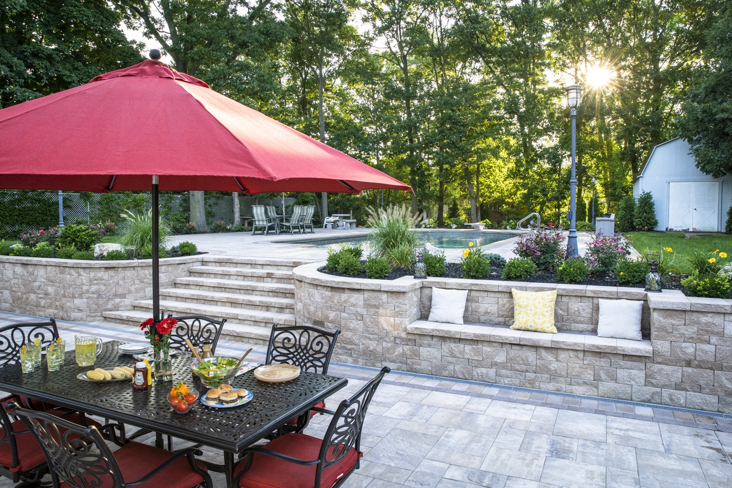 Landscape design with swimming pool in East Northport, NY