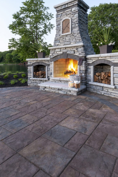 How to Choose Between Gas or Wood-Burning for Your Huntington, NY, Outdoor Fireplace