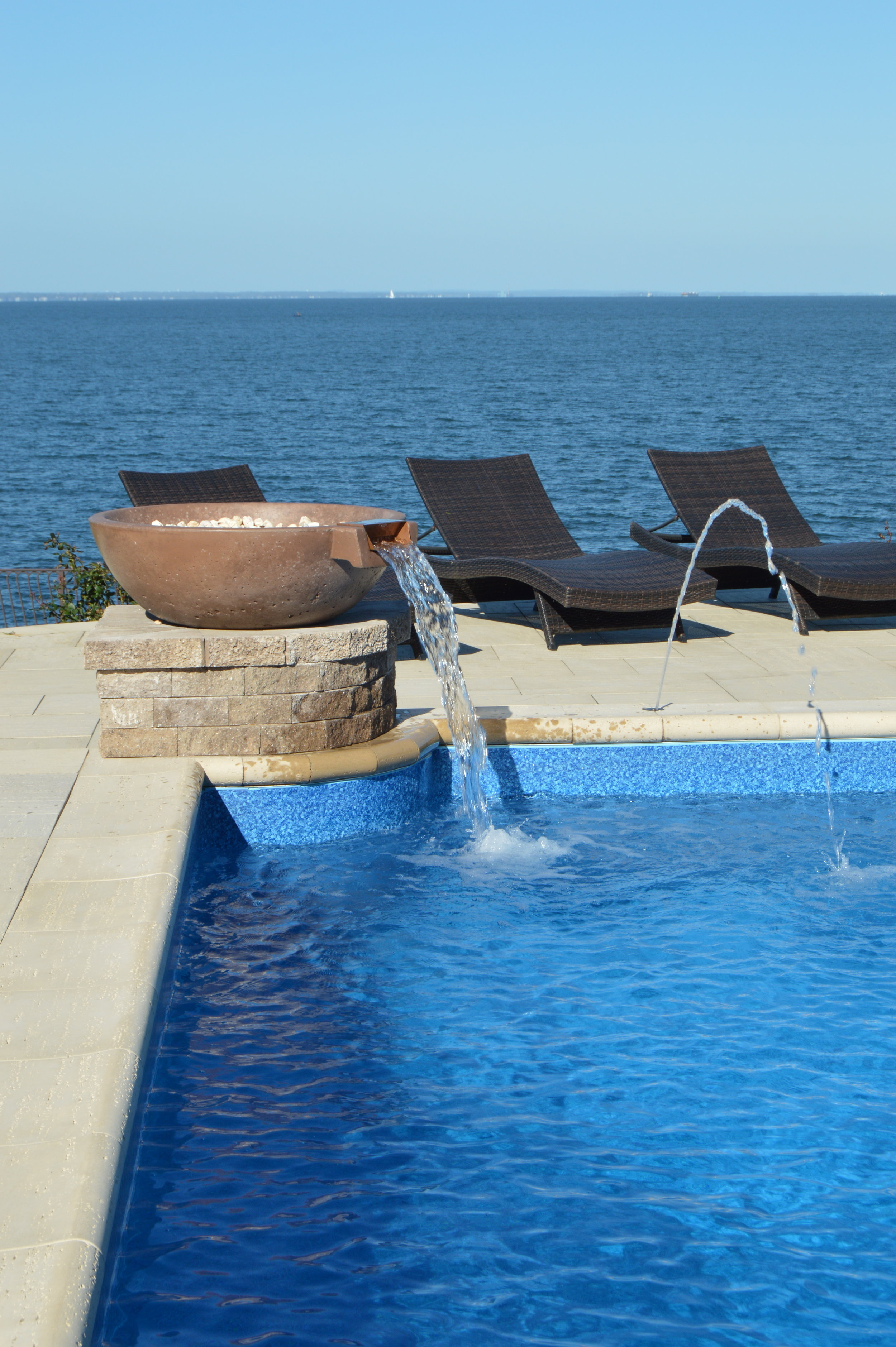 Include One of These Stunning Water Features for Your Hicksville, NY, Swimming Pool Design