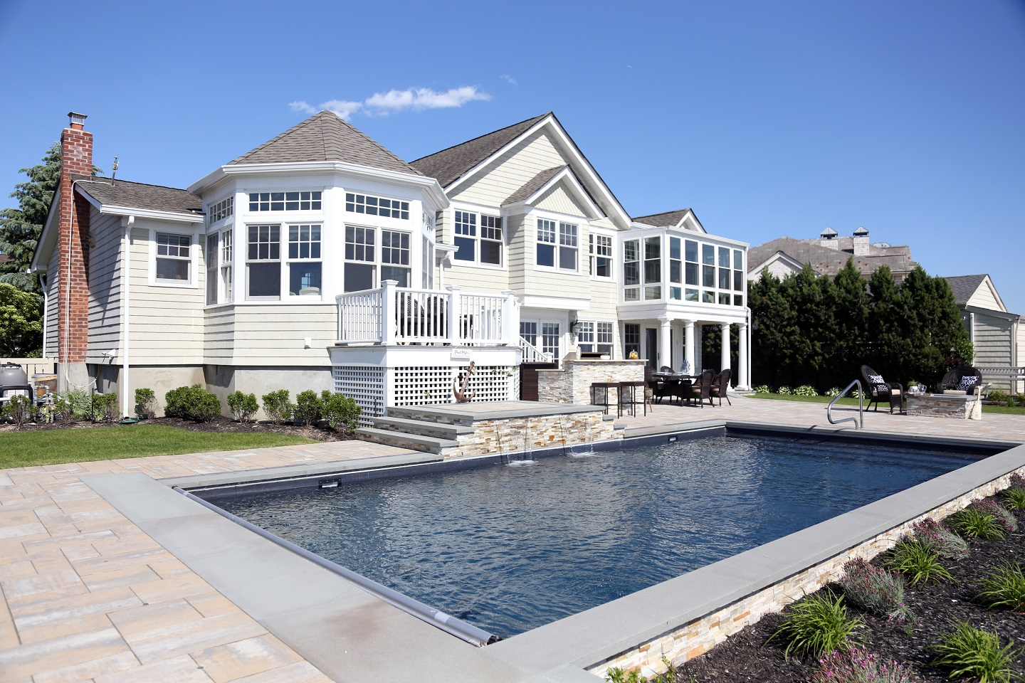 Landscape design with swimming pool in Huntington Station NY