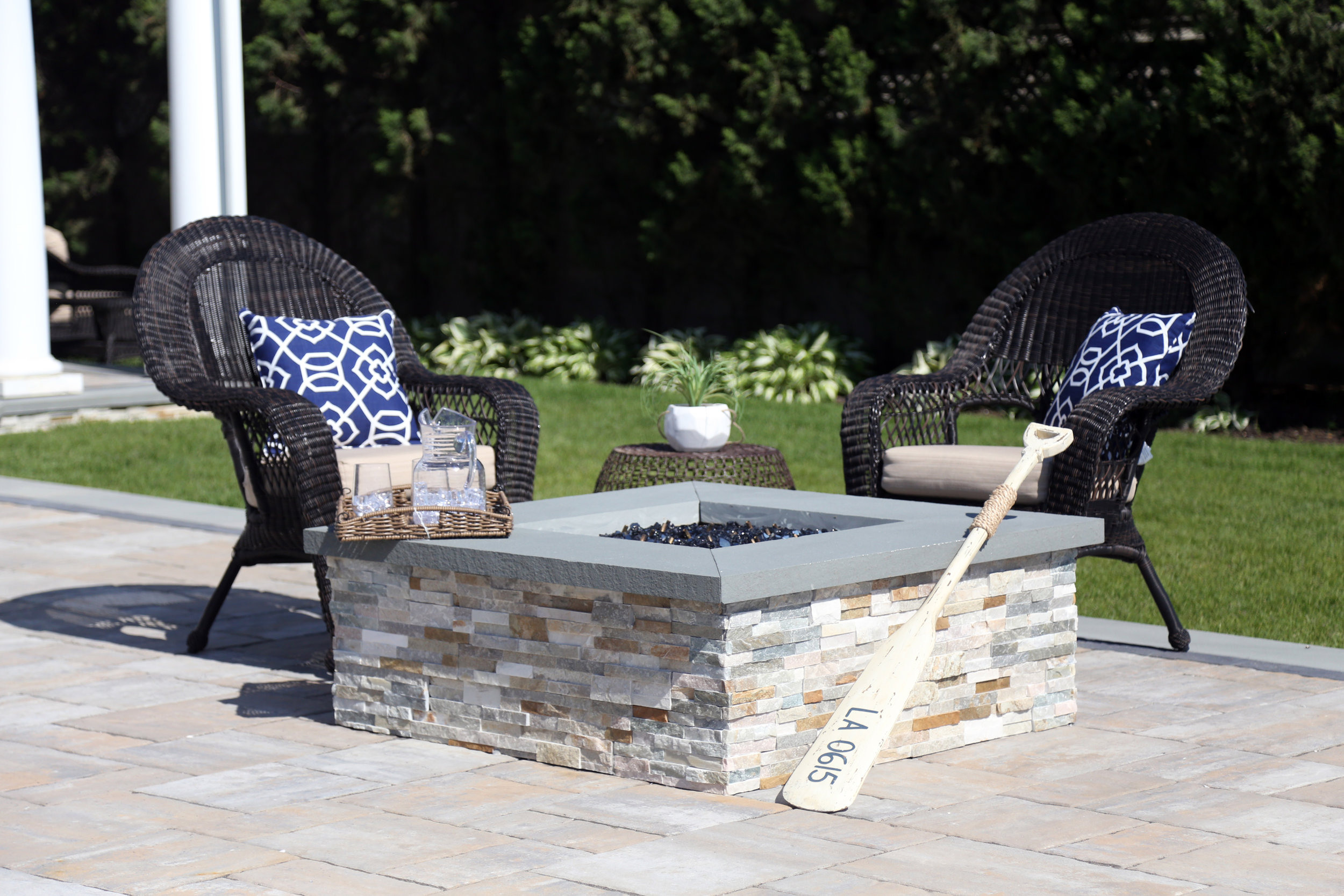Patio with outdoor fireplace in Melville NY