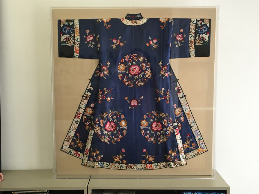Chinese robe, mounted on linen and encased in an acrylic frame.