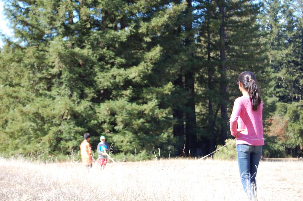 Students use scientific tools to measure redwoods during WOLF School's Growing Redwood Stewards program at Little Basin, part of Big Basin Redwoods State Park.
