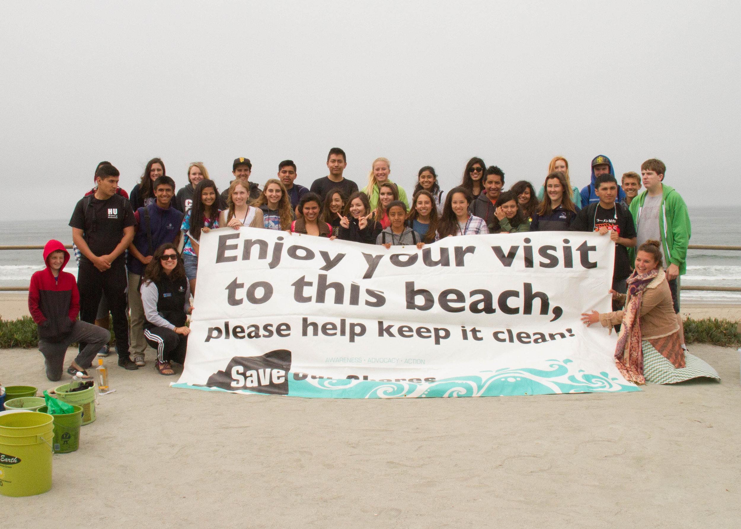 Students participate in a Save Our Shores beach clean-up. By collaborating with WOLF School, Save Our Shores is able to reach a whole new sector of central California's youth, and WOLF School is able to integrate a deeply impactful lesson into their outdoor science school program.