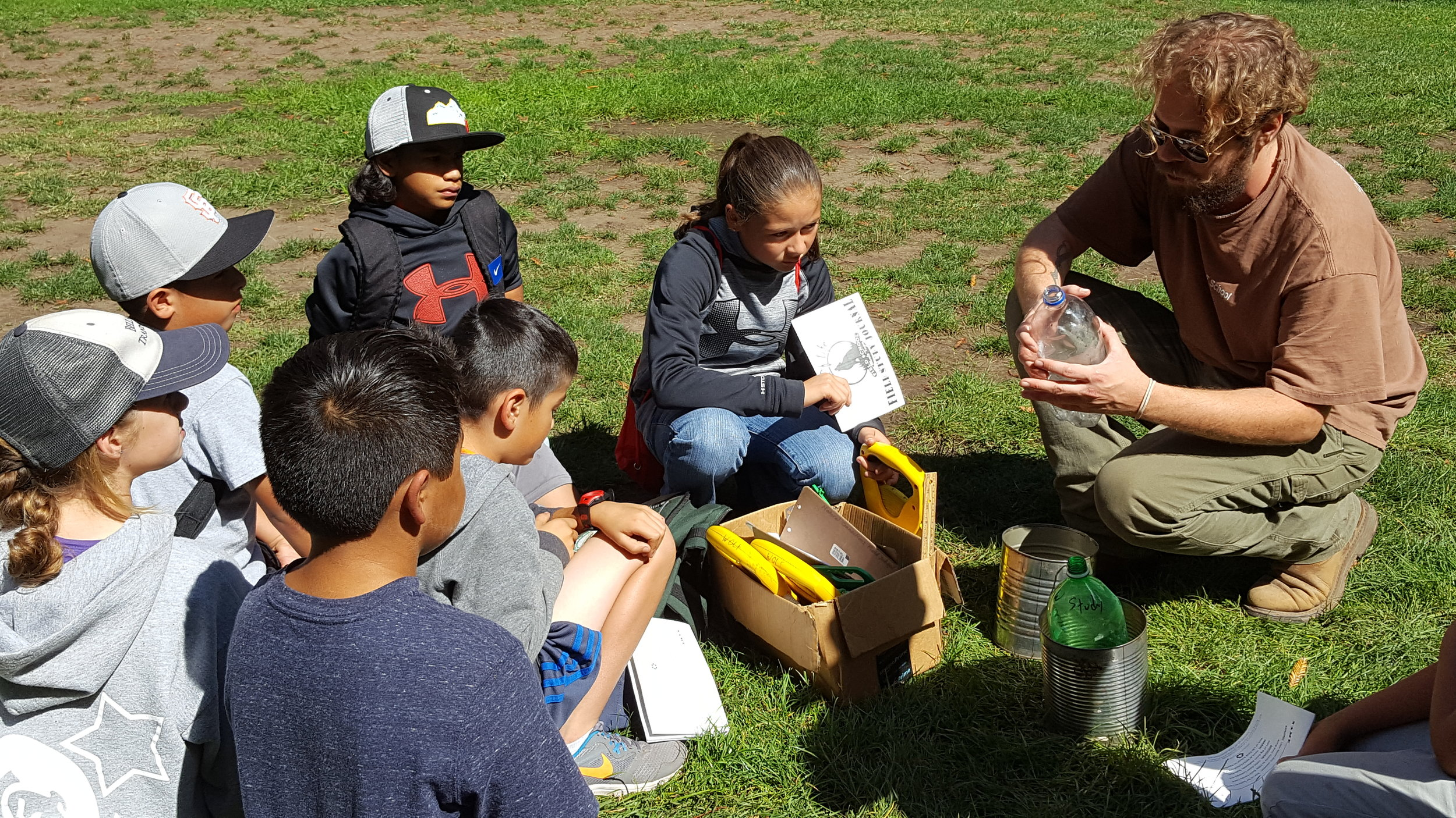 WOLF School Program Director Chris Soriano, aka Otter, explains usage of scientific equipment before students participate in redwood study.