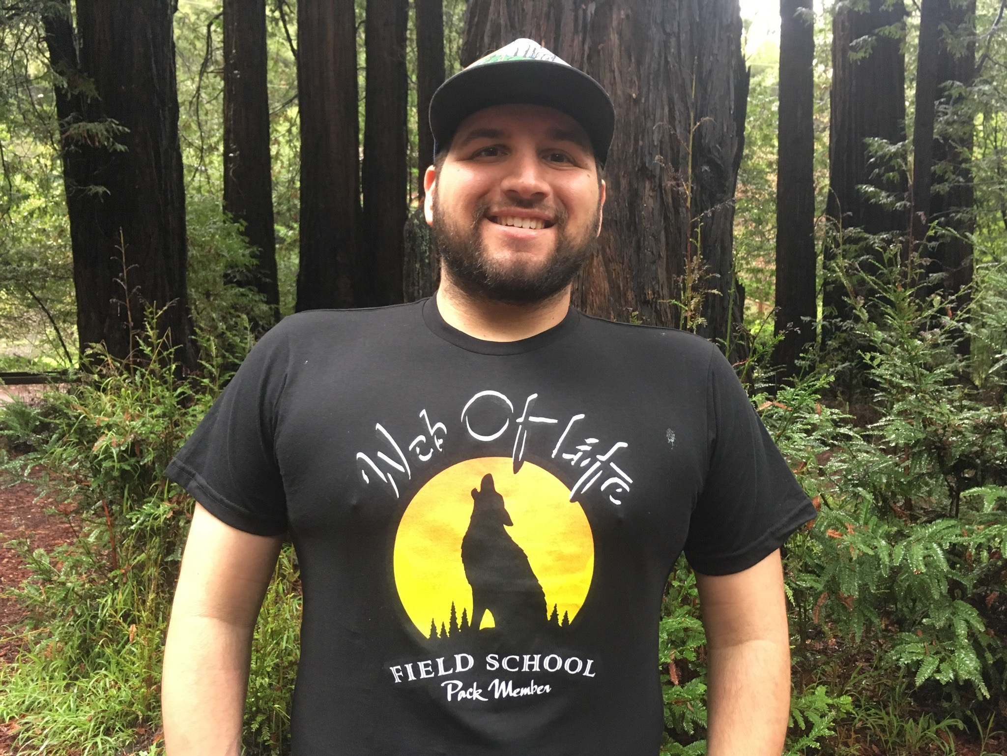 New WOLF School Merch! 100% Recycled T-Shirt in Black, Worn by Naturalist Treetop.jpg
