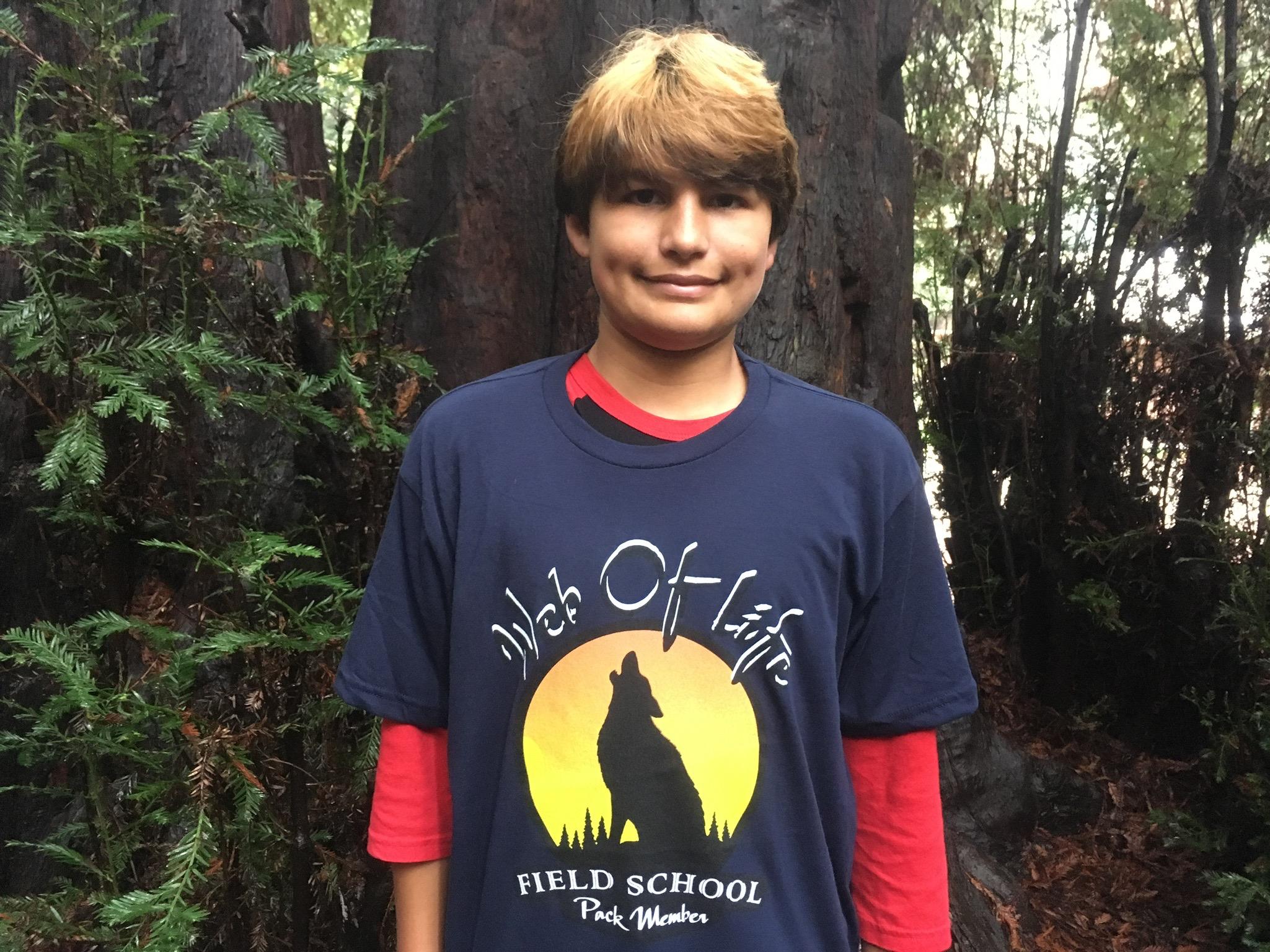 New WOLF School Merch! 100% Recycled T-Shirt in Navy, Worn By WOLF School Day Camper.jpg