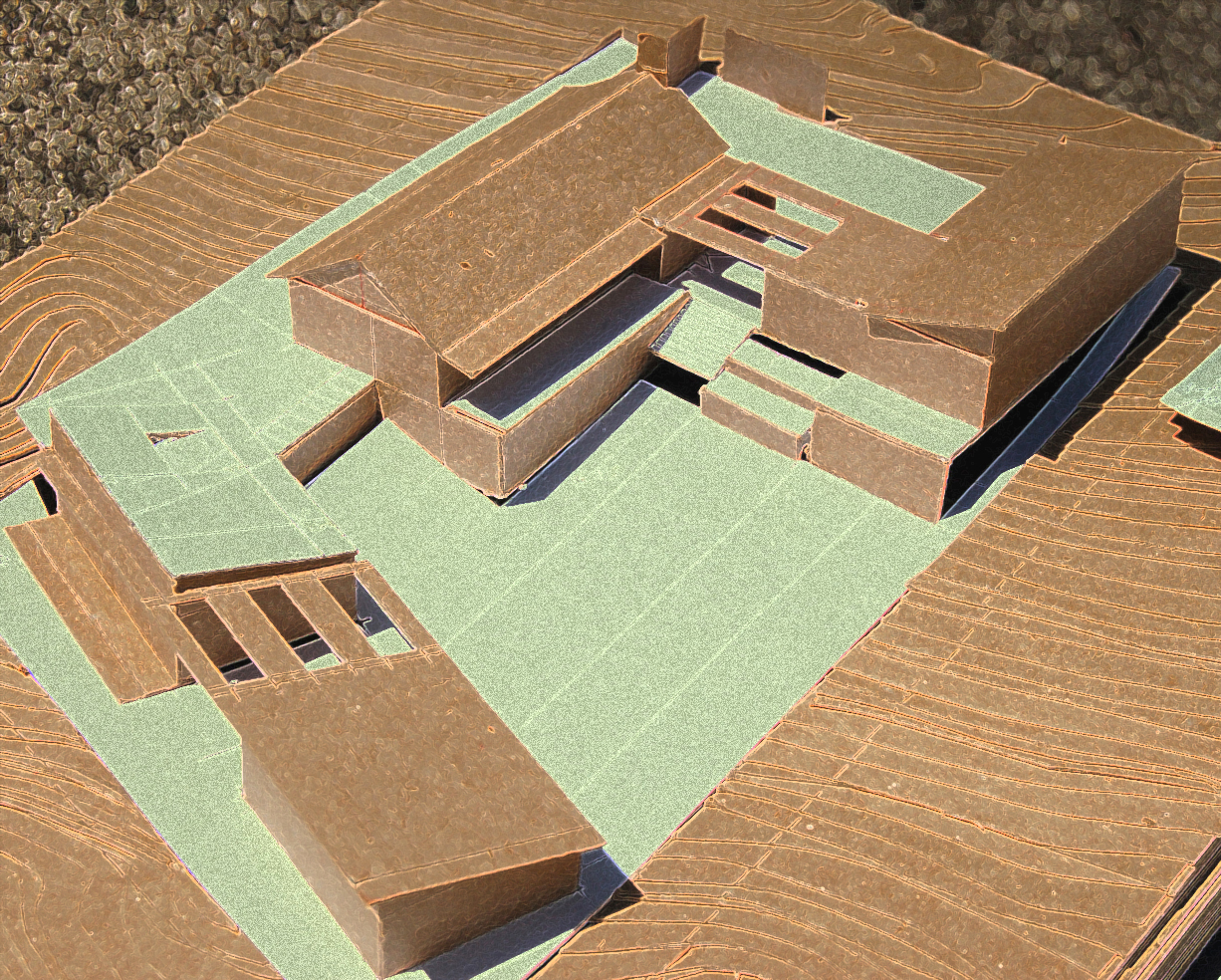 stylized model view showing massing of house and reaction to topography