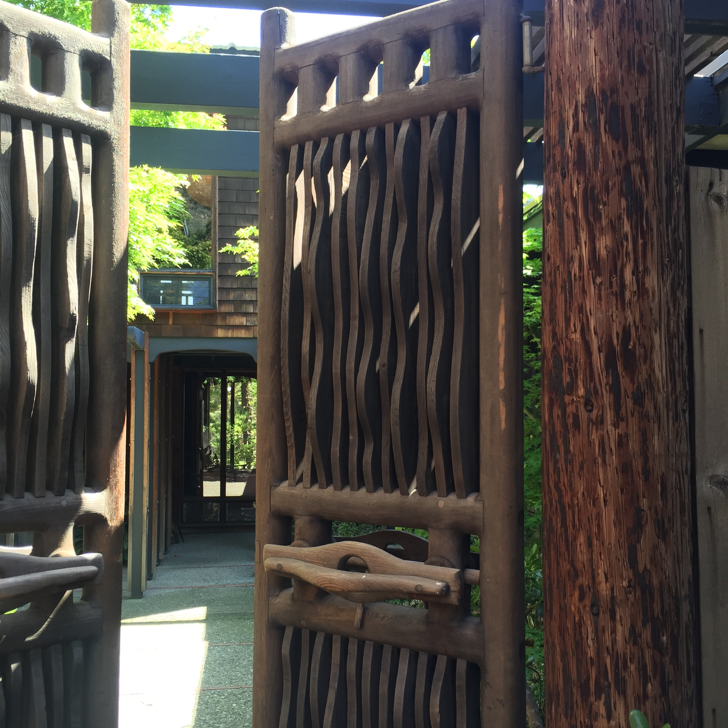 one of several artful entrances that Maloof crafted through the gardens and his house