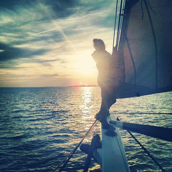 Enjoying one of the many beautiful sunsets over the Sound on the bowsprit.