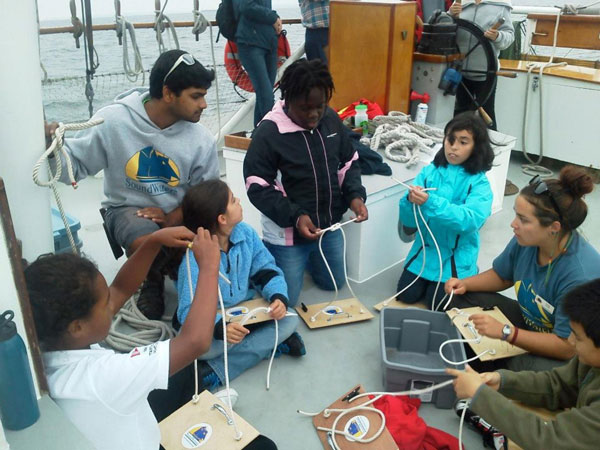 Crewmate Rohan and I in knots class with some of our visiting students.