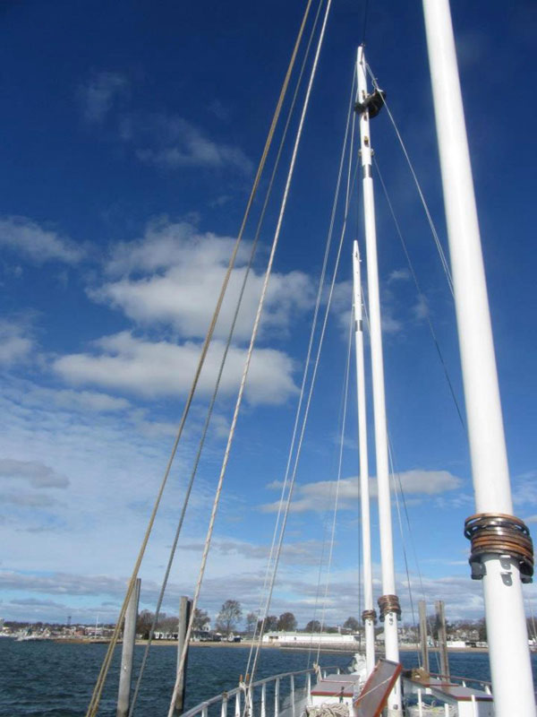 Another perspective of me working on the center mast. It was very intimidating being that high with only one rope holding you in place!