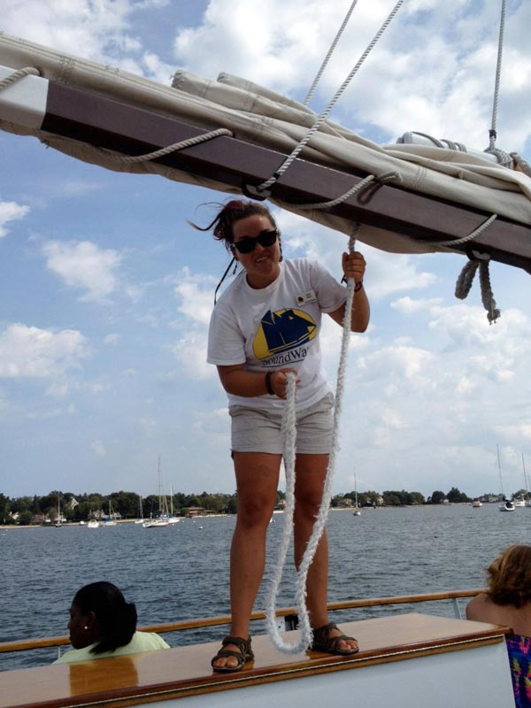 Tying down the sails for docking. Another beautiful day on the Long Island Sound!