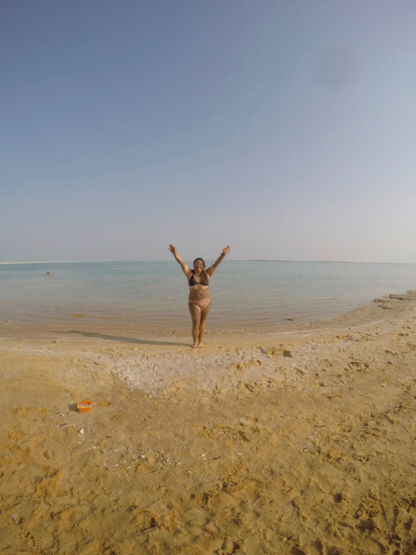 Hamming it up at the Dead Sea, saltiest place on Earth. Covered in Dead Sea mud, widely popular around the world for it's healing properties.