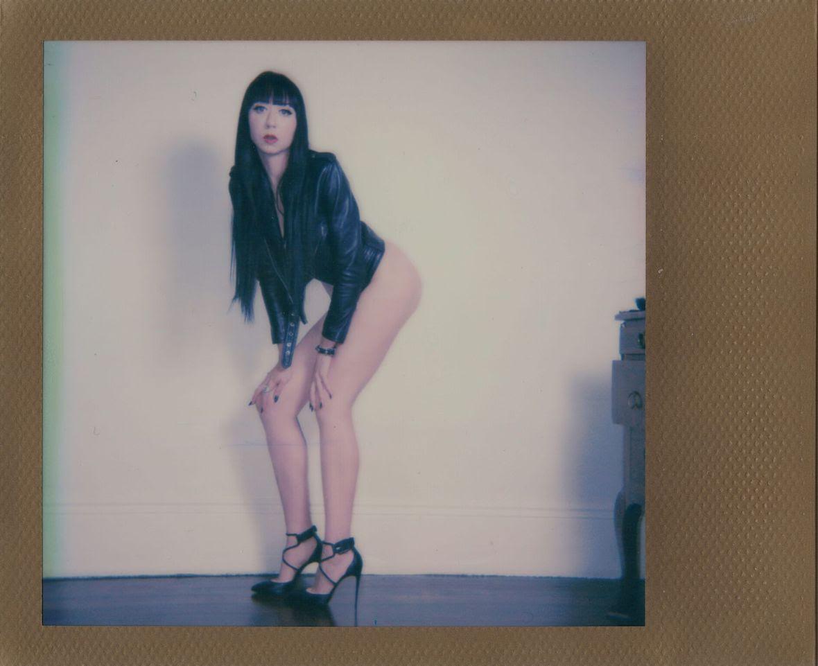 Mistress_Ramona_Ryder_SF_San_Francisco_Escort_Dominatrix_Domme_leather_punk_bangs_pale_goth_louboutin_long_legs_high_heels.jpg