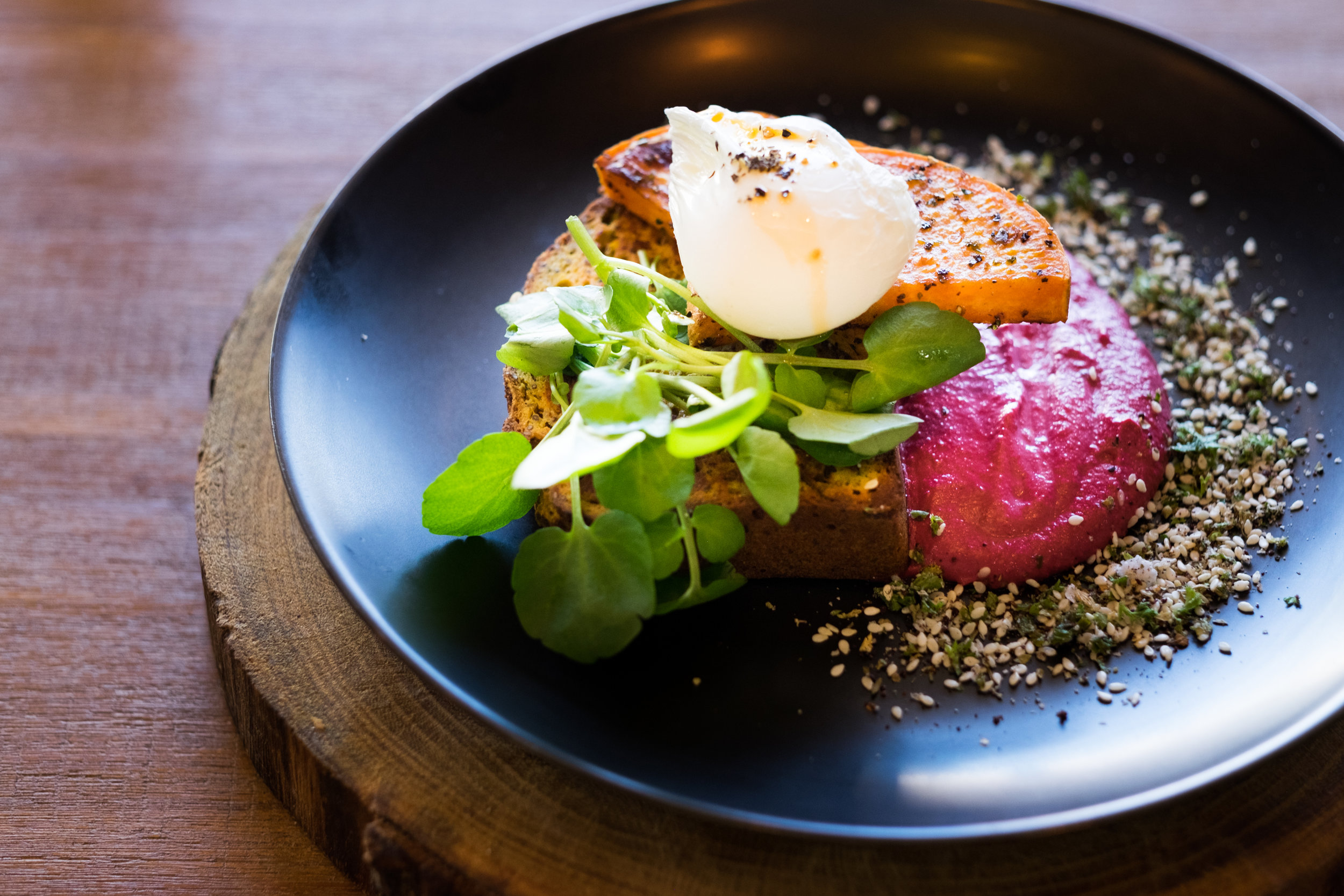 Paleo Pumpkin Bread, sweet potato, beetroot tahini, poached free range egg