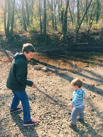 My friend's,Sarah, two son's engaged in a stick match! My favorite parts are their smiles!